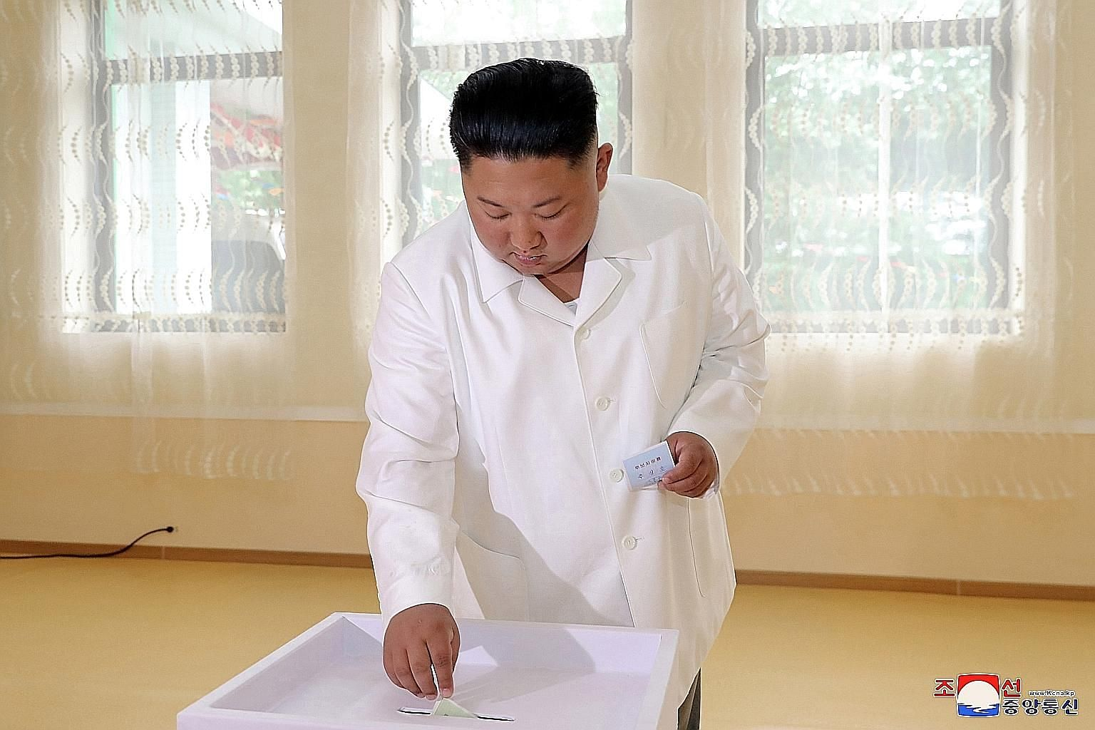 North Korean leader Kim Jong Un voting in North Hamgyong province on Sunday for two candidates running for seats in the area's county assemblies. PHOTO: EPA-EFE