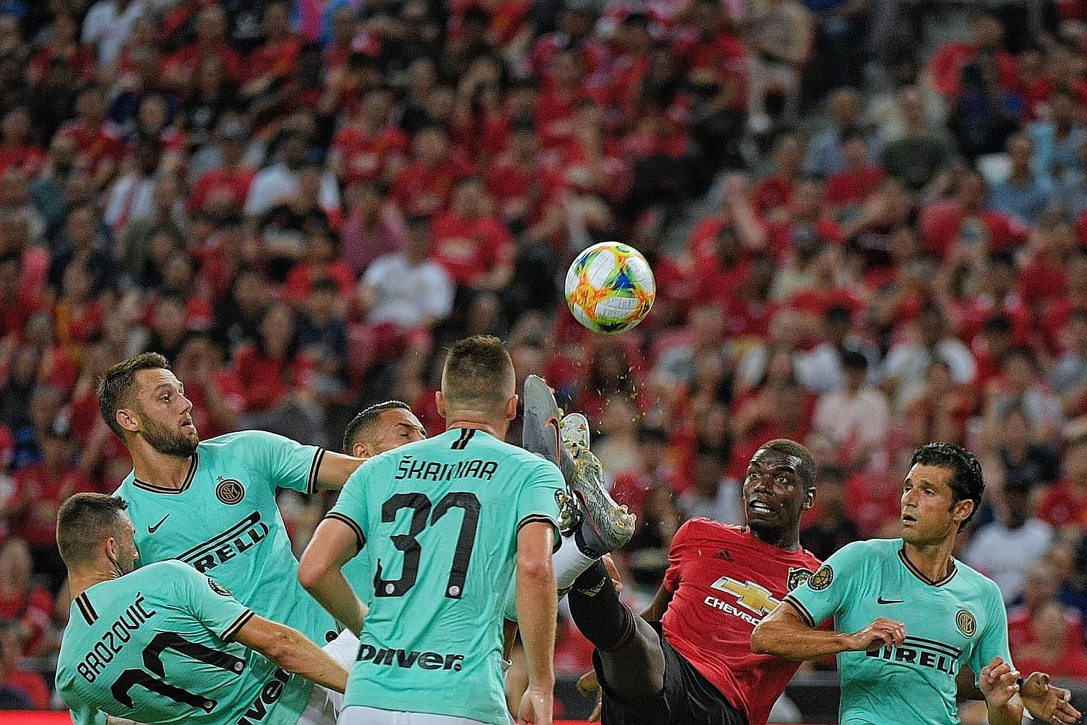 Midfielder Paul Pogba took on a host of Inter Milan players as Manchester United ran out 1-0 winners on Saturday, with the English side's supporters filling the National Stadium on their team's first visit to Singapore since 2001.