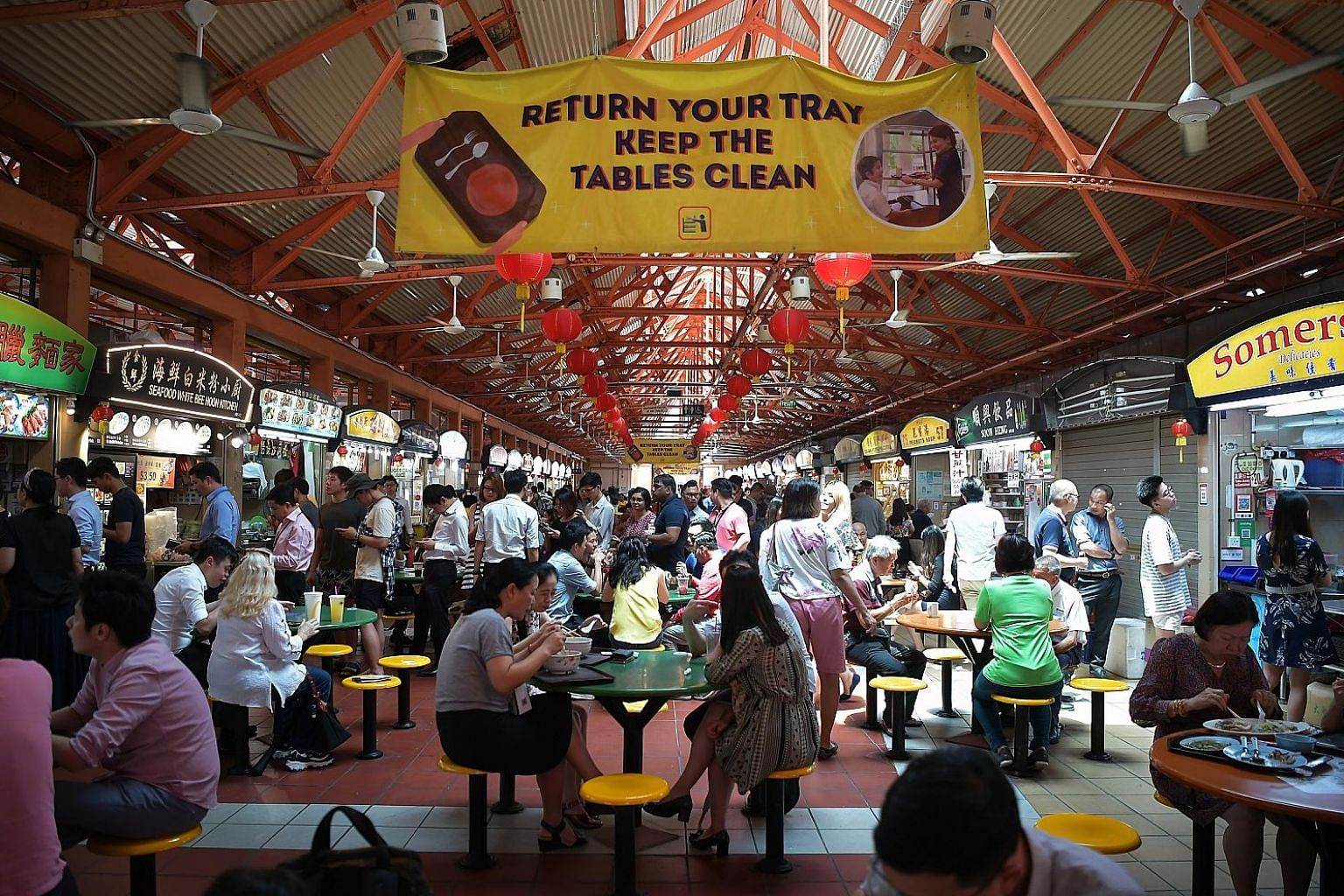 Diners can redeem sets of reusable cutlery (on a first-come, first-served basis) at selected hawker centres such as Maxwell Food Centre (left).