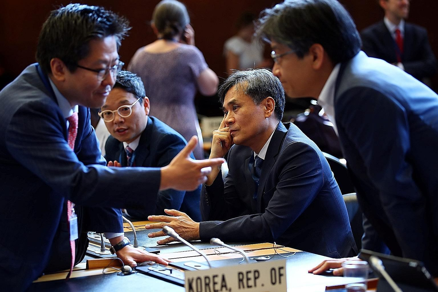 South Korea Deputy Trade Minister Kim Seung-ho (centre) at the WTO General Council meeting yesterday in Geneva, Switzerland, where Seoul argued that Japan's trade measures amounted to political retaliation over a spat on wartime labour, given that th