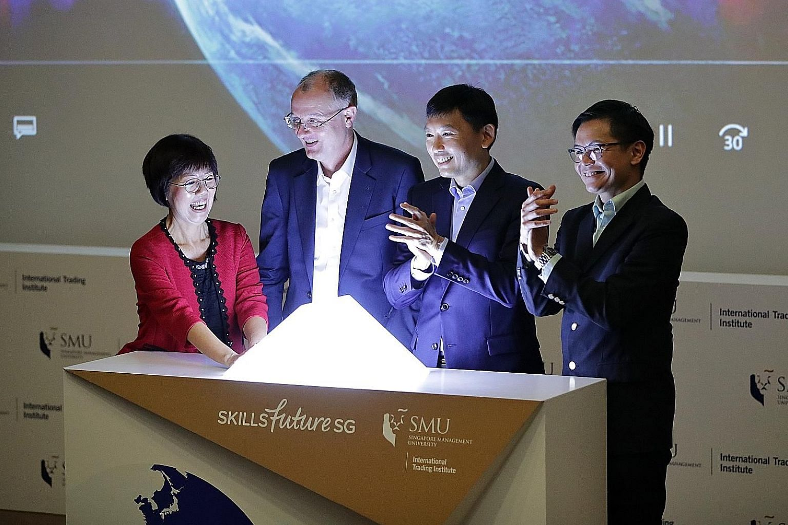 The new iTalent Solutions Map being launched at Singapore Management University yesterday by (from far right) SkillsFuture Singapore chief executive Ng Cher Pong, Senior Minister of State for Trade and Industry and Education Chee Hong Tat, SMU provos