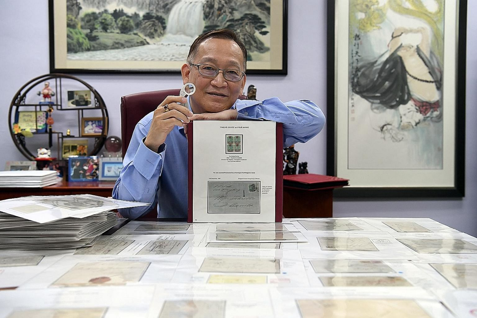 Avid stamp collector Richard Tan's (above) pieces include a 12-anna error stamp (right) and an extremely rare 1890 North Borneo cover (far right).