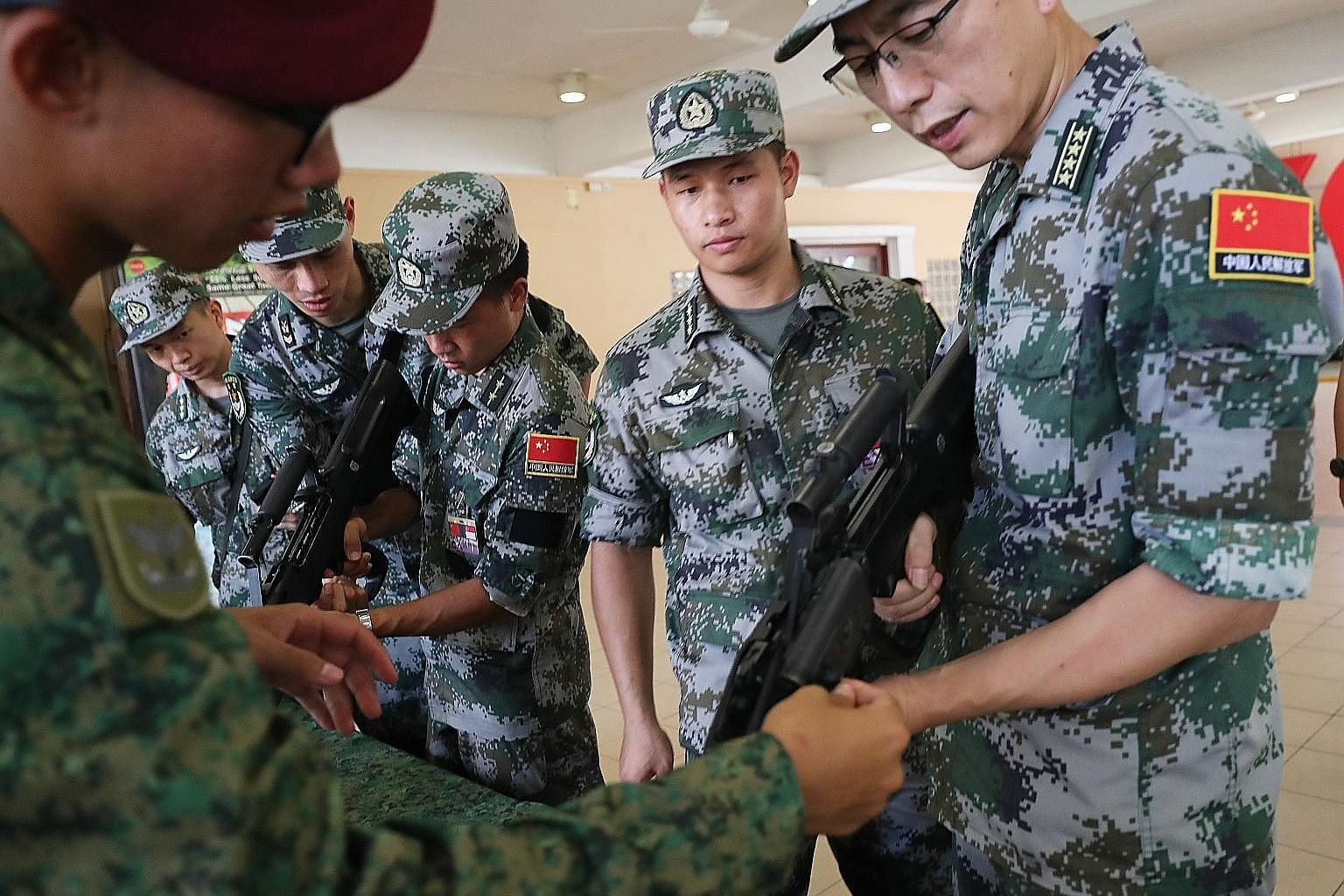 Exercise Cooperation involves about 240 soldiers from the Singapore Army's 3rd Singapore Division and 1st Commando Battalion, as well as the People's Liberation Army's Southern Theatre Command Army's 74th Army Group. PHOTO: LIANHE ZAOBAO