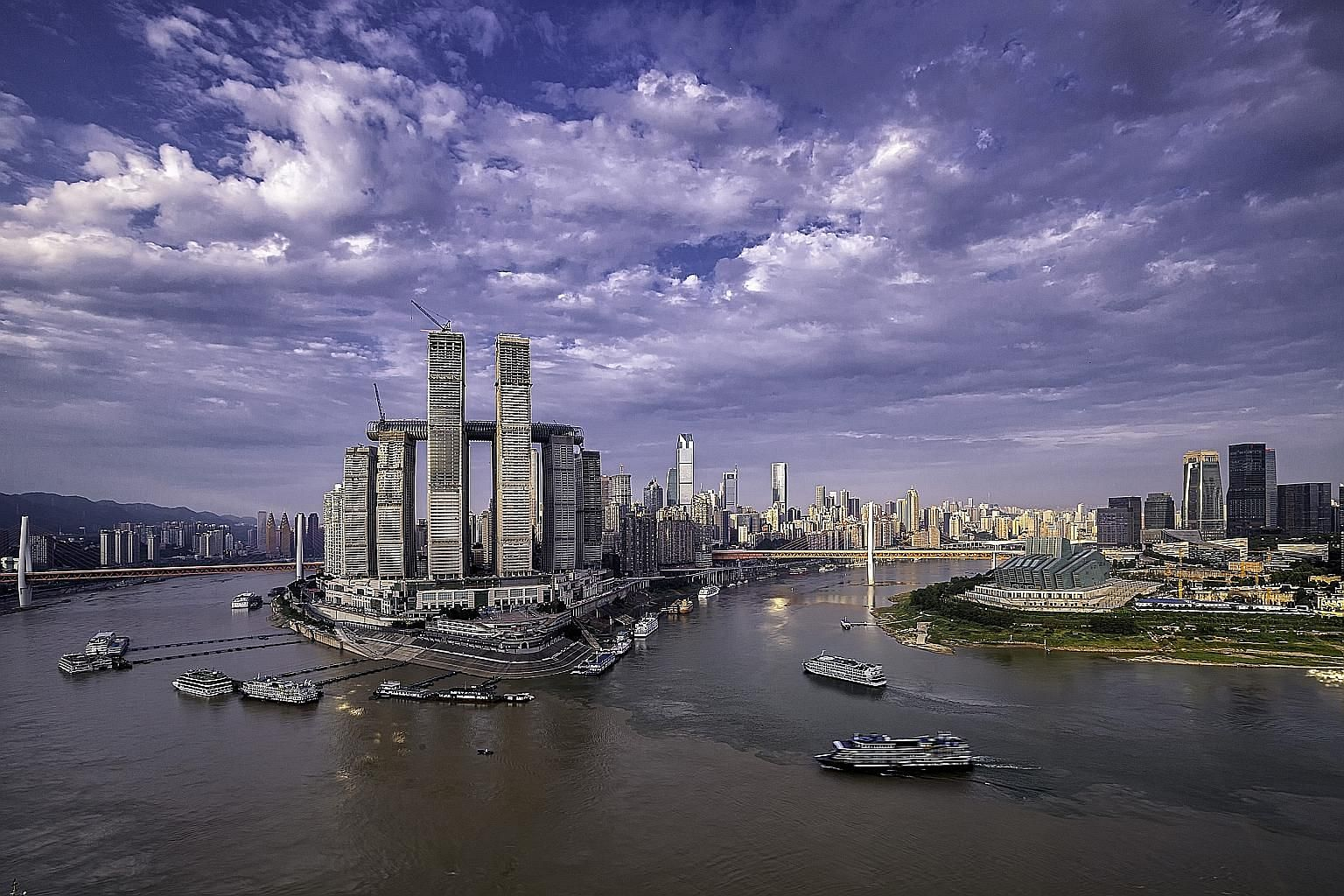 CapitaLand's mega-mall, part of the Raffles City Chongqing complex, is expected to open in September. The project is on the historic Chaotianmen site where the Jialing River meets the Yangtze River. PHOTO: CAPITALAND