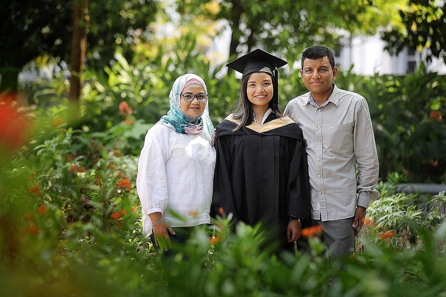Singapore Management University graduate Farah Abdul Malik with her parents, Madam Fatimah Alwi and Mr Abdul Malik Rahman Shah. Ms Farah is currently enrolled in a two-year fast-track Master of Philosophy in Psychology programme at the university.