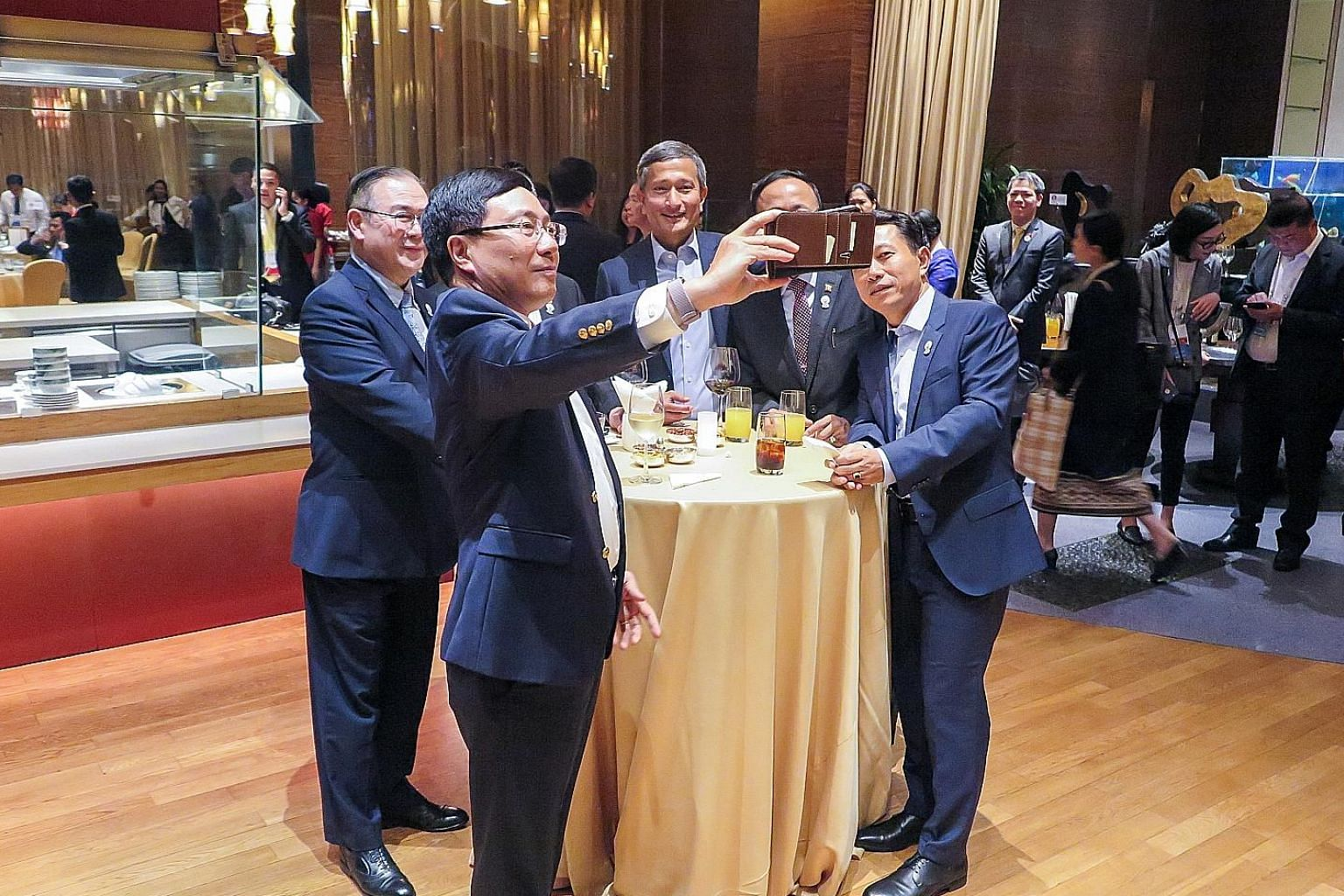 Foreign Minister Vivian Balakrishnan (centre in picture) arrived in Bangkok yesterday to attend the Asean Foreign Ministers' Meeting and related discussions like the East Asia Summit and Asean Regional Forum. The annual Asean Foreign Ministers' Meeti