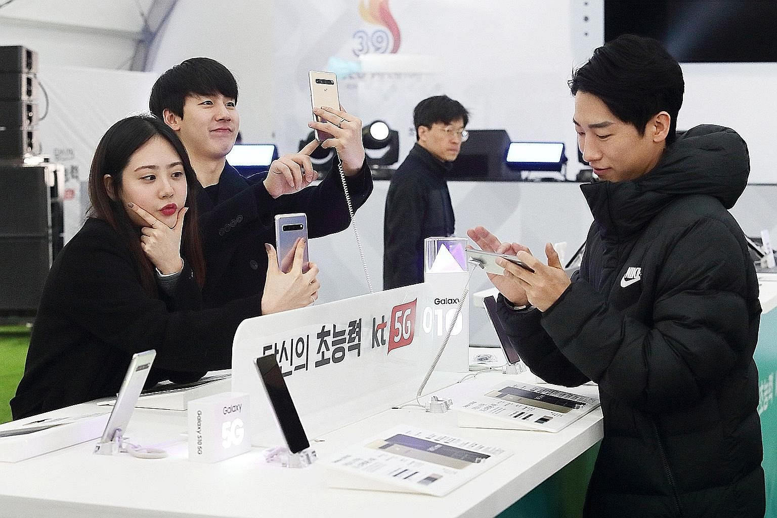 Patrons trying out Samsung's Galaxy S10 5G phones in Seoul earlier this year. In April, it was forced to delay the release of its Galaxy Fold model after reports of screen problems.