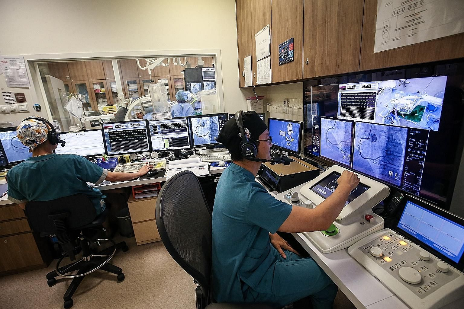 Tan Tock Seng Hospital's team is the first in South-east Asia to use this new technology to perform robotic-assisted angioplasty. The surgeon controls the robotic arm from a workstation outside the operating theatre.