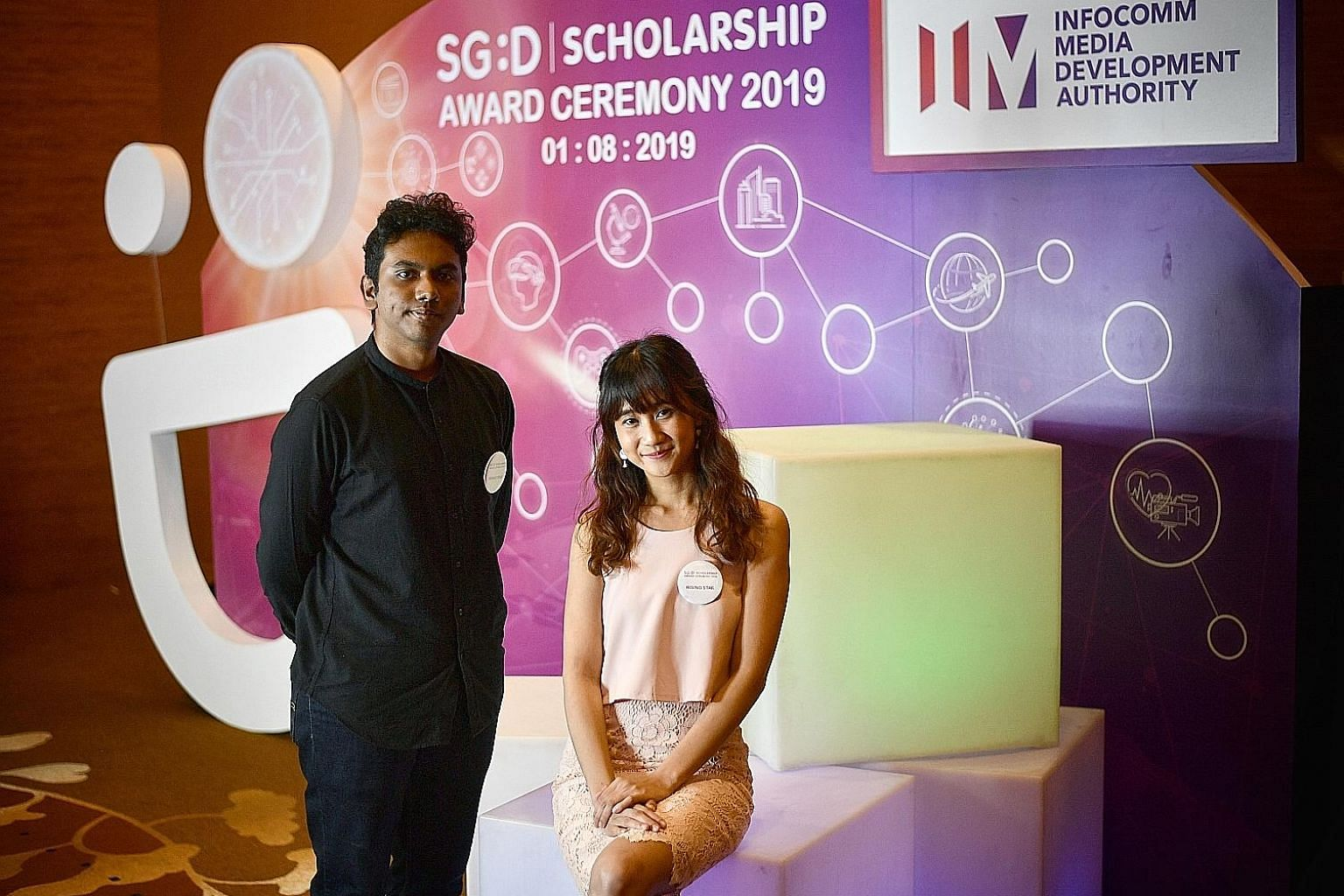 Mr Nishok and Ms Farren Tang are among the 81 recipients of the Infocomm Media Development Authority's inaugural Singapore Digital Scholarship. Mr Nishok plans to major in film and production at university, while Ms Tang is pursuing a master's degree