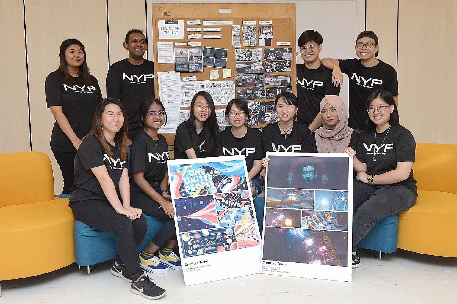 Students from Nanyang Polytechnic's School of Interactive & Digital Media, including 20-year-old Natalie Tan (first row, at far right), with storyboards of the animations they have created on Singapore's past, present and future for this year's Natio