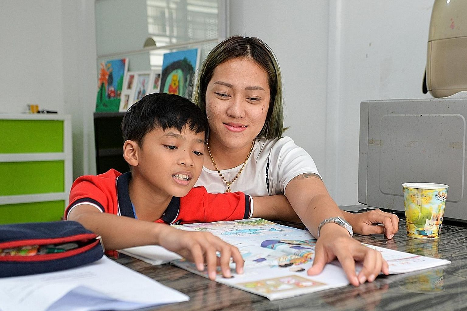 Children like Tanabordee (seen here with his mother Wanwisa Lim) who are exposed to multiple languages tend to demonstrate greater cognitive flexibility and may enjoy advantages for life.