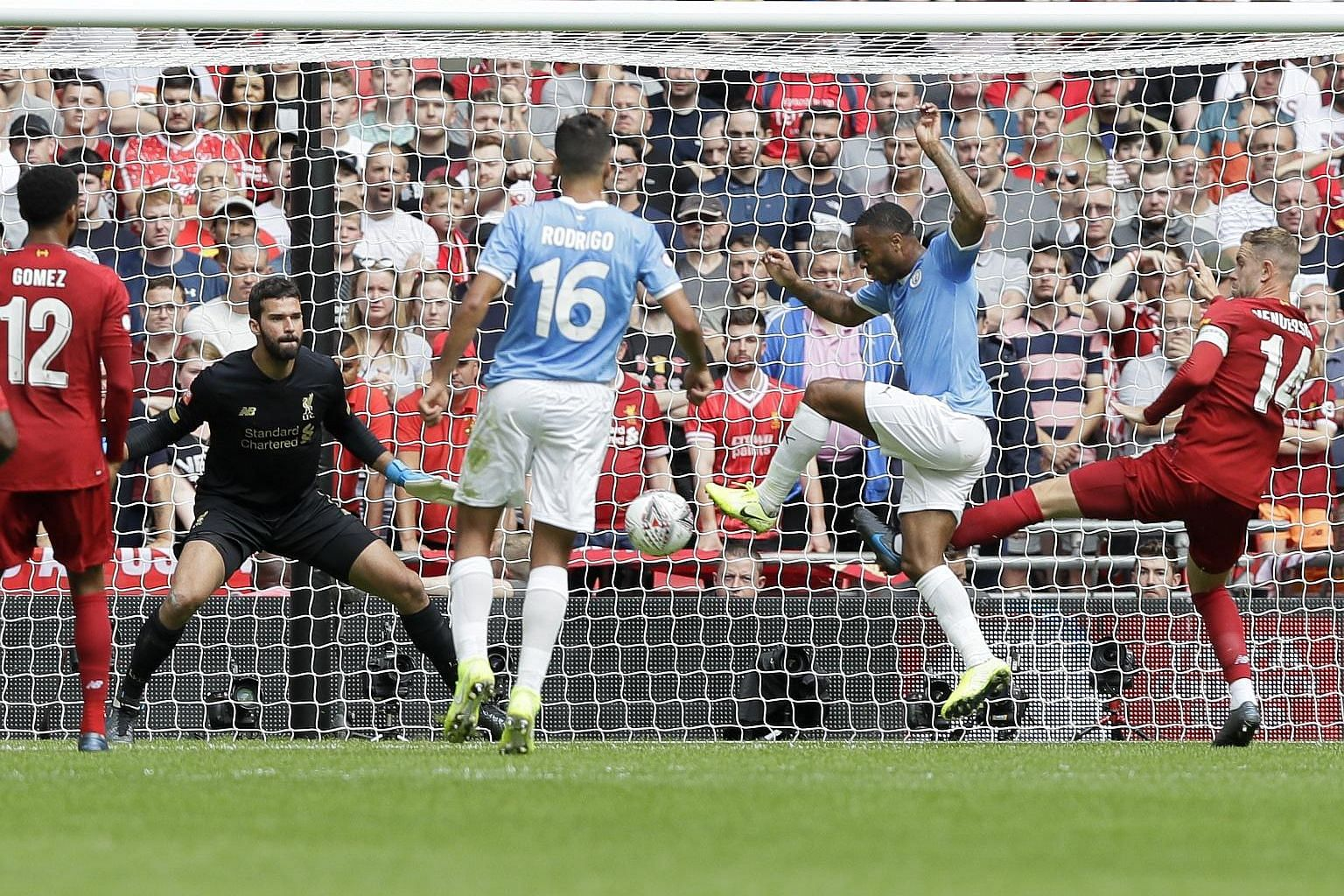 Raheem Sterling opening accounts for Manchester City against Liverpool in the English Community Shield match at Wembley yesterday. Joel Matip equalised to take the game to penalties, with City edging it 5-4.