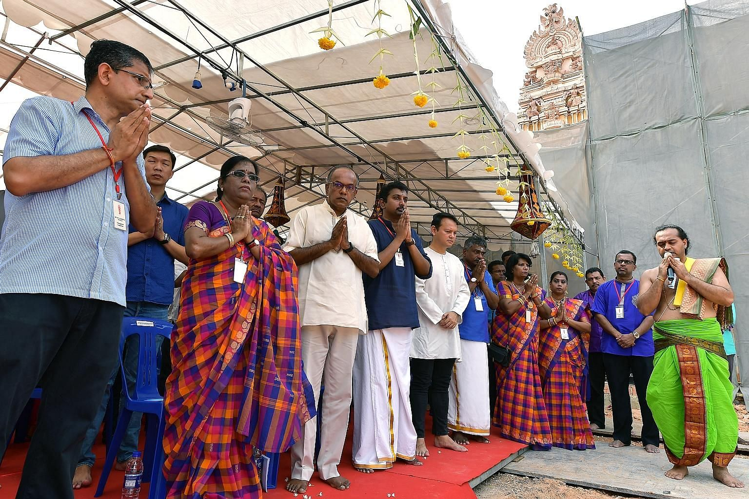 Law and Home Affairs Minister K. Shanmugam (front row, third from left) and Minister of State for National Development and Manpower Zaqy Mohamad (front row, fifth from left) at the ground-breaking ceremony for the Sri Siva Krishna Temple's annex yest