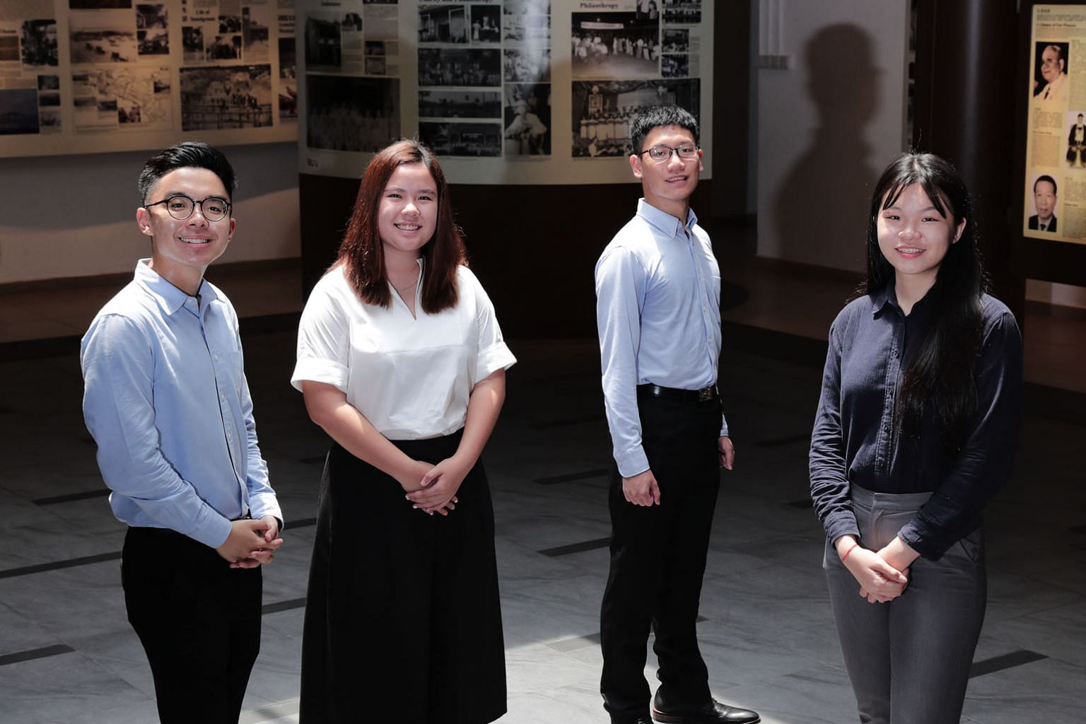 (From left) Mr Ng Joong Hwee, Ms Jazlin Tan Kaiqian and Mr Loy Wei Peng from Hwa Chong Institution, as well as Ms Grace Chong Qiao Yi from Eunoia Junior College clinched the Singapore Federation of Chinese Clan Associations' bond-free scholarship to