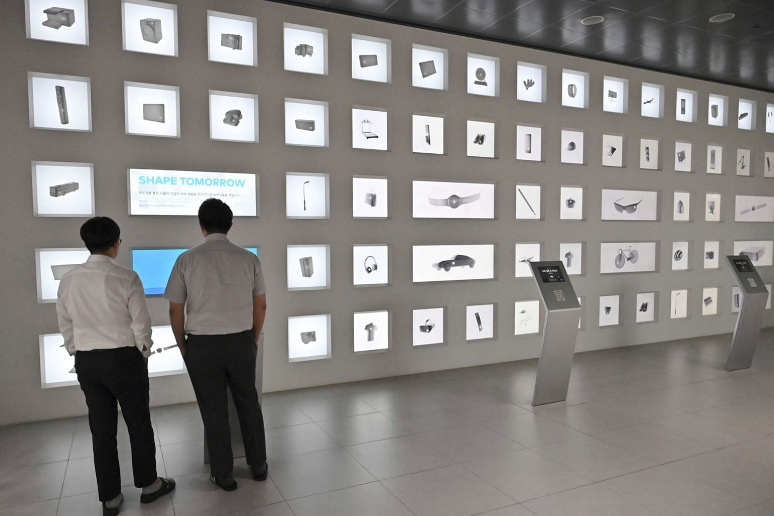 """Visitors in a Samsung Electronics showroom in Seoul. A Samsung spokesman said the firm was """"seeking ways to diversify"""" supplies of materials and components where it relied heavily on Japanese imports."""