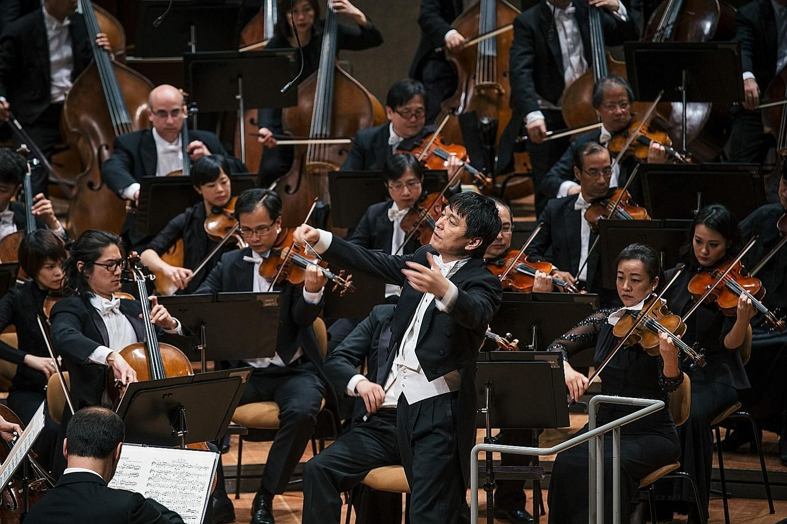 In a photo taken in 2016, conductor laureate Lan Shui is seen leading the Singapore Symphony Orchestra during a performance in Berlin.