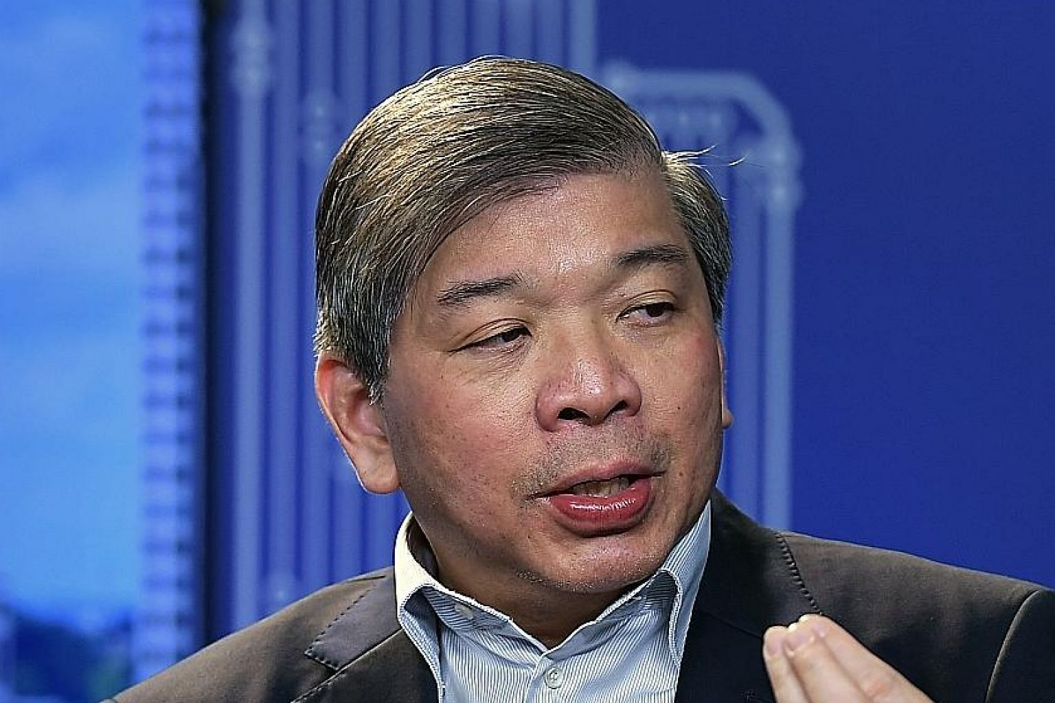 Mr Teo Siong Seng encourages Singaporeans to have a sense of community, camaraderie and the kampung spirit to help one another. ST FILE PHOTO