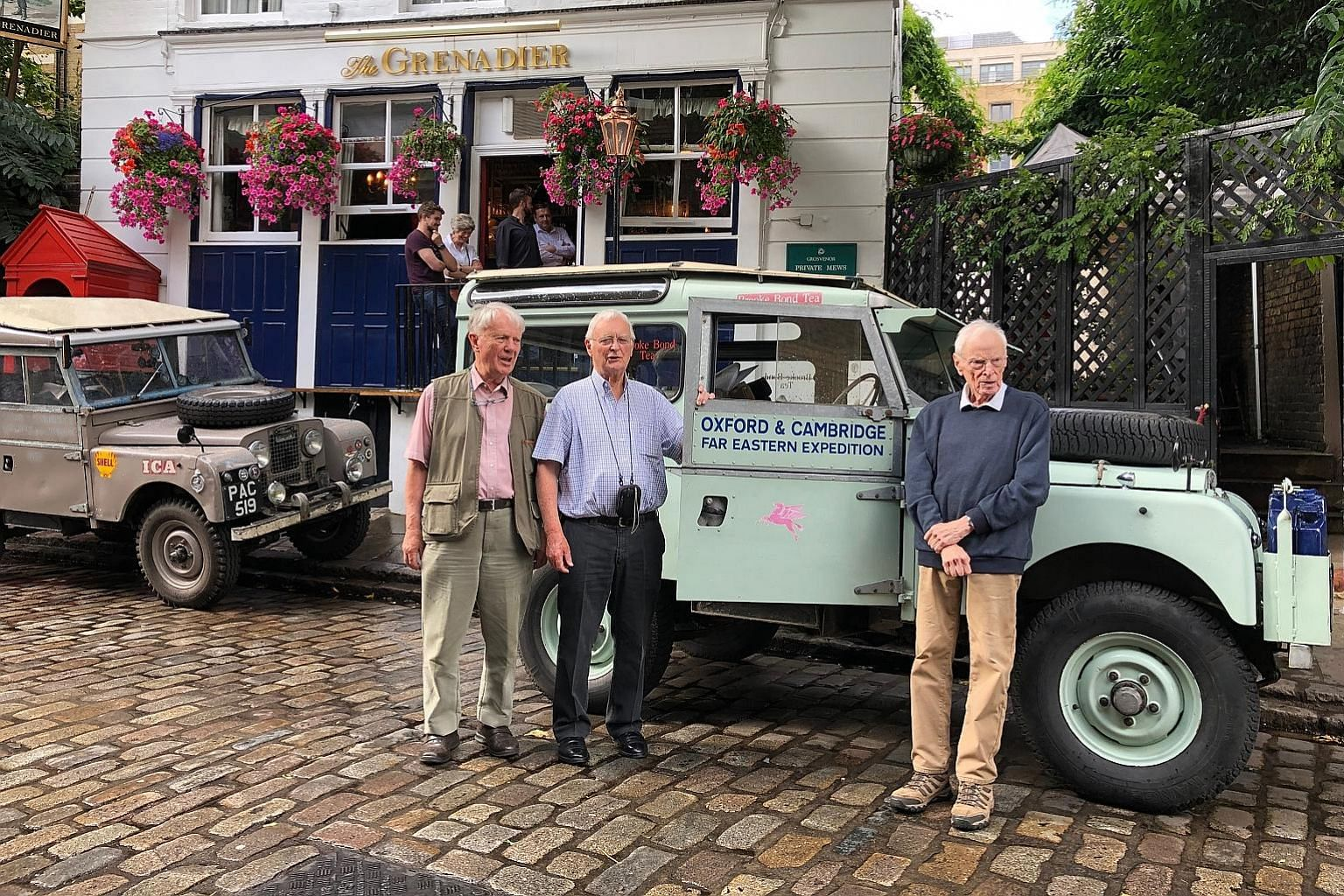 (From left) Mr Nigel Newbery, Mr Pat Murphy and Mr Tim Slessor, members of the 1955 overland trip from London to Singapore, with a replica of a Land Rover used on that trip. Mr Slessor is part of the team embarking on the Singapore to London trip on