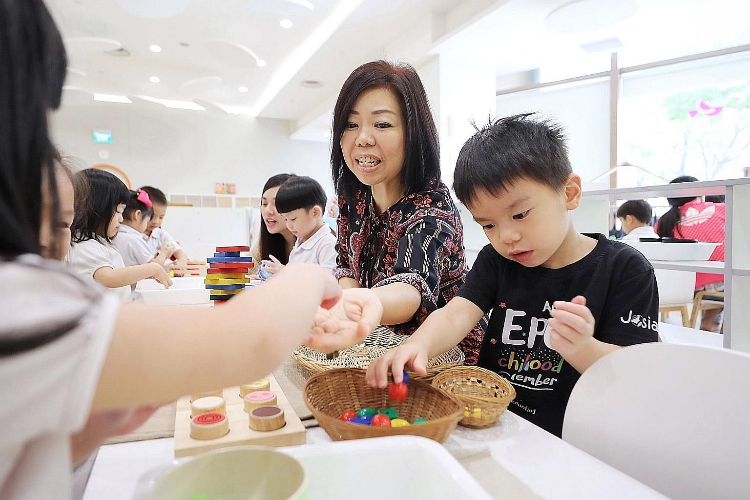 PayNow makes it convenient for parents, said Ms Wendy Tan (foreground), co-founder of Josiah, seen here at the group's Suntec City centre with principal Germaine Kok. ST PHOTO: GAVIN FOO
