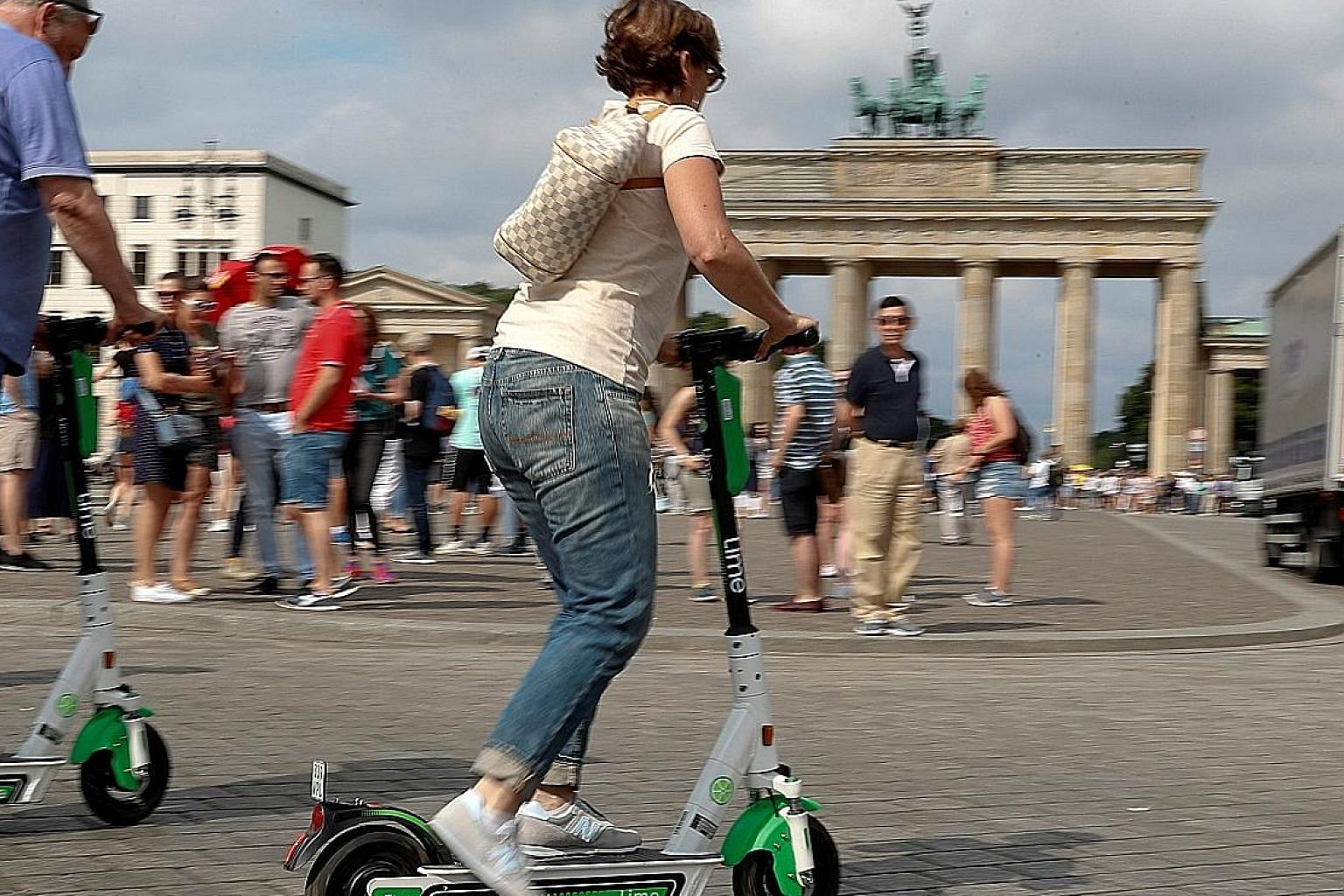 An e-scooter rider at the Brandenburg Gate in Berlin in June. It is estimated that there are now 5,000 e-scooters on the city's streets and, in the two months since they appeared, they have been involved in 40 accidents. PHOTO: REUTERS
