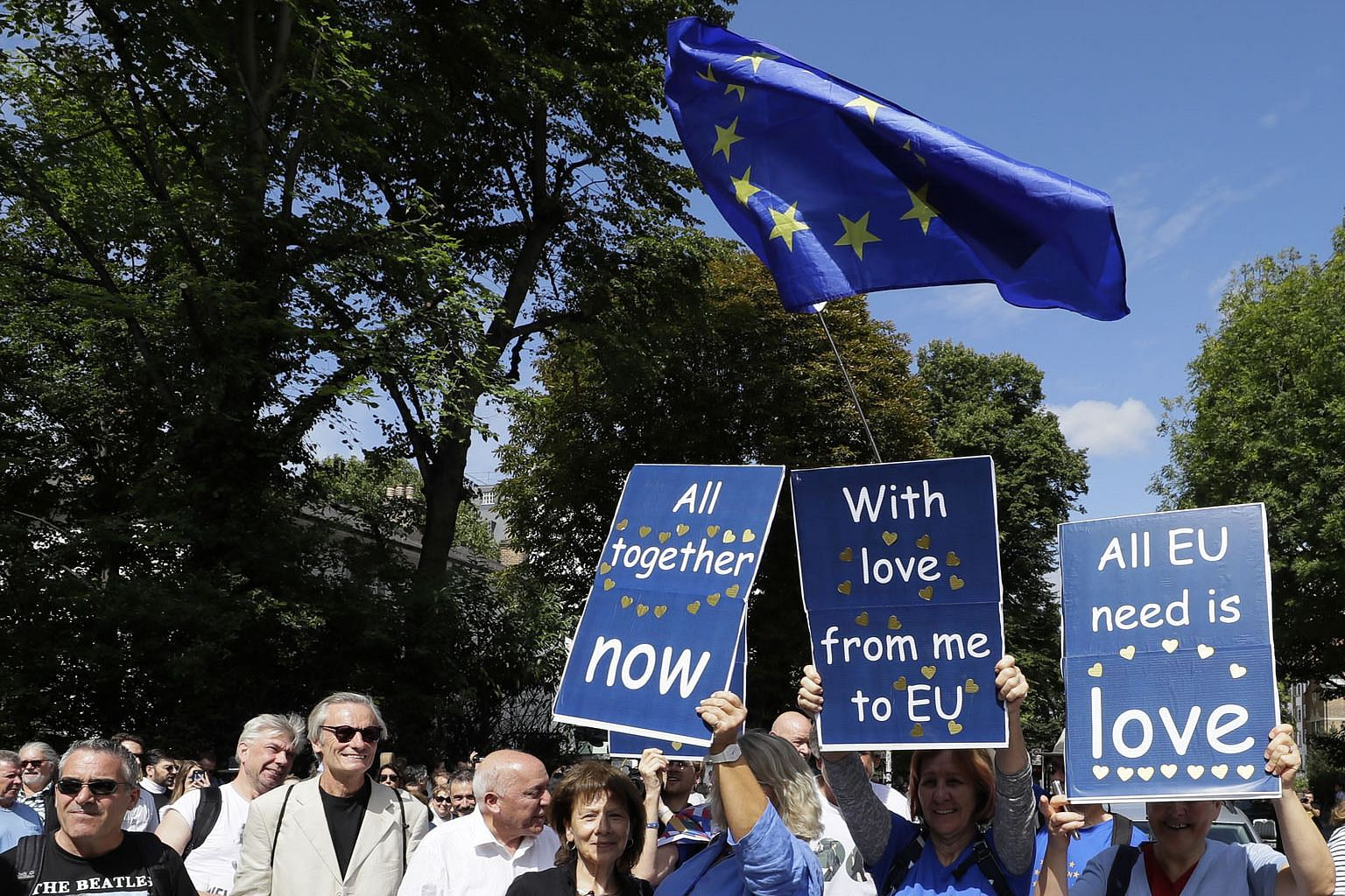 Anti-Brexit demonstrators joining Beatles fans in Abbey Road, London on Thursday, on the 50th anniversary of The Beatles crossing the street that was immortalised on the cover of their album Abbey Road.