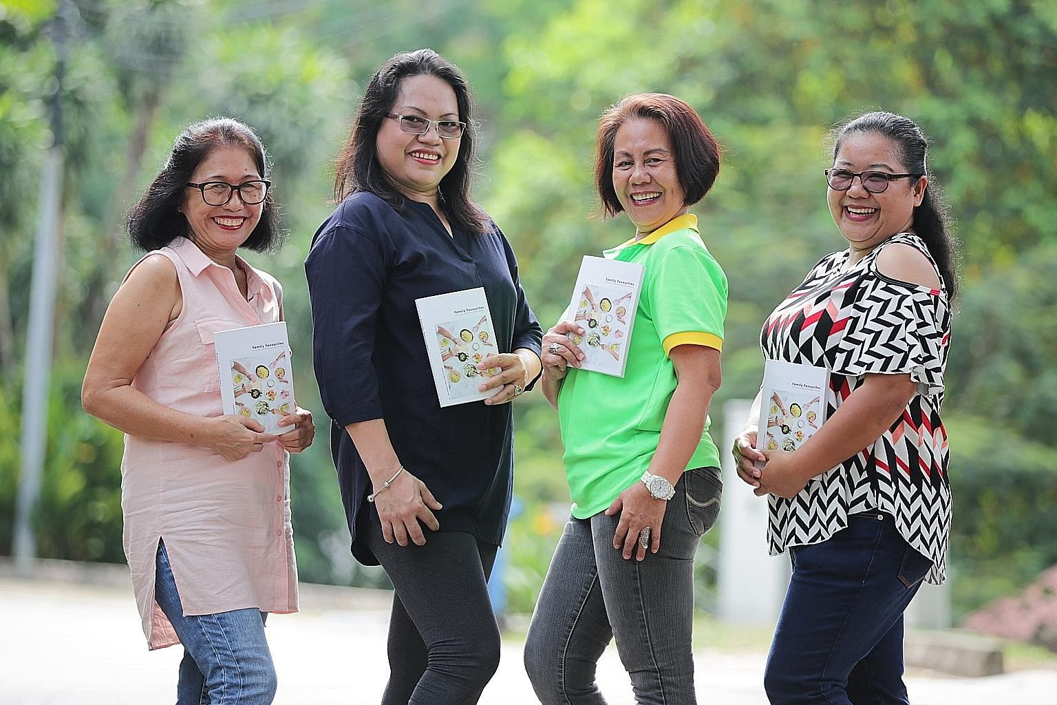 Four of the five authors of Family Favourites: (from left) Ms Lita Patricio, Ms Jetky Amores, Ms Jomarcy Bebida and Ms Carina Rebuya. Fellow author Rose Buenvenida has returned to the Philippines. Ms Patricio's favourite fish curry dish (below) is fe