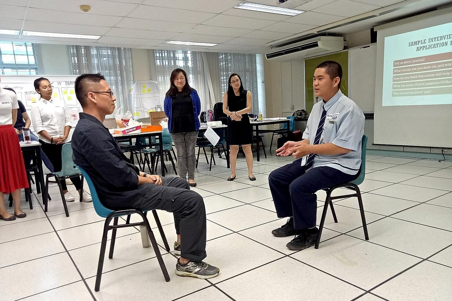 Northbrooks Secondary School principal Nick Chan (left) doing a mock interview with Secondary 3 student Ding Zhao Yang in a workshop organised by Access. The group's pilot run in June involved 19 students.