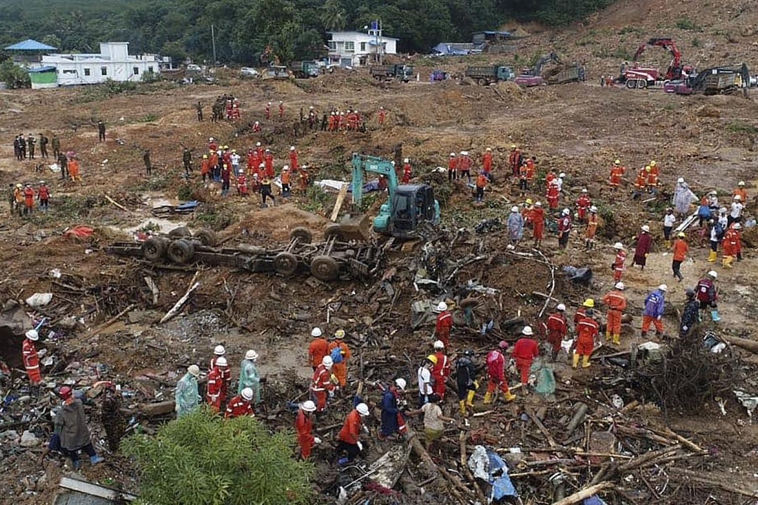 A photo from the Myanmar Fire Service Department showing rescue workers at a landslide-hit area in Paung township, Mon state, yesterday. A bulletin from the International Federation of Red Cross and Red Crescent Societies says more than 134,000 peopl
