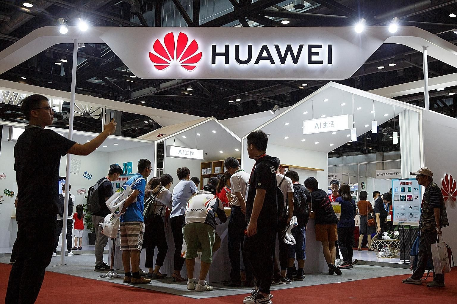 The Huawei booth at the International Consumer Electronics Expo in Beijing early this month. Going hard on Huawei was the wrong way for the United States to confront China over its grievances - even if many of them are entirely valid, says the writer