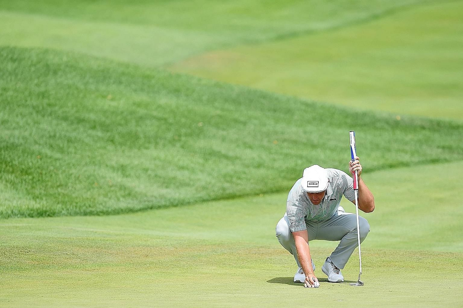 Bryson DeChambeau lining up a putt at last week's Northern Trust tournament in New Jersey. The American golfer was criticised for slow play last Friday after taking 139 seconds to putt. PHOTO: AGENCE FRANCE-PRESSE