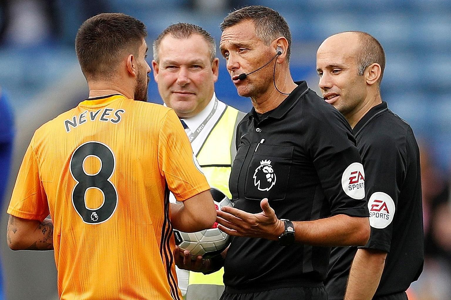 Wolves midfielder Ruben Neves protesting referee Andre Marriner's decision to rule out a goal following a VAR review. PHOTO: REUTERS