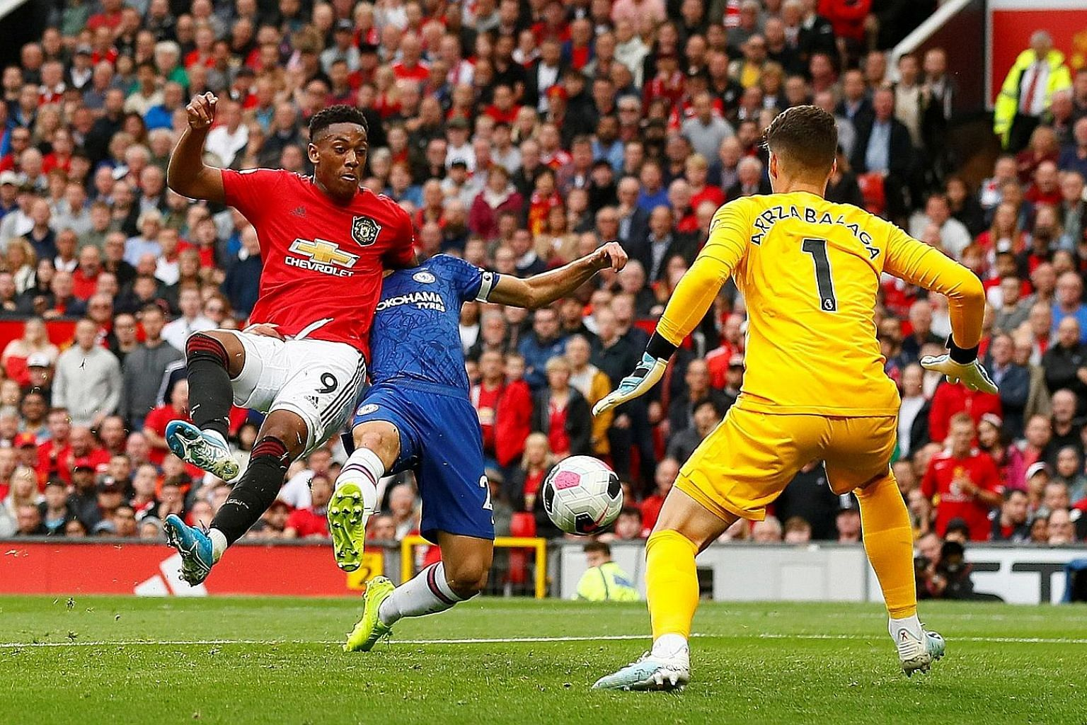 Anthony Martial holding off a challenge from Cesar Azpilicueta to knock home their second goal past Chelsea goalkeeper Kepa.