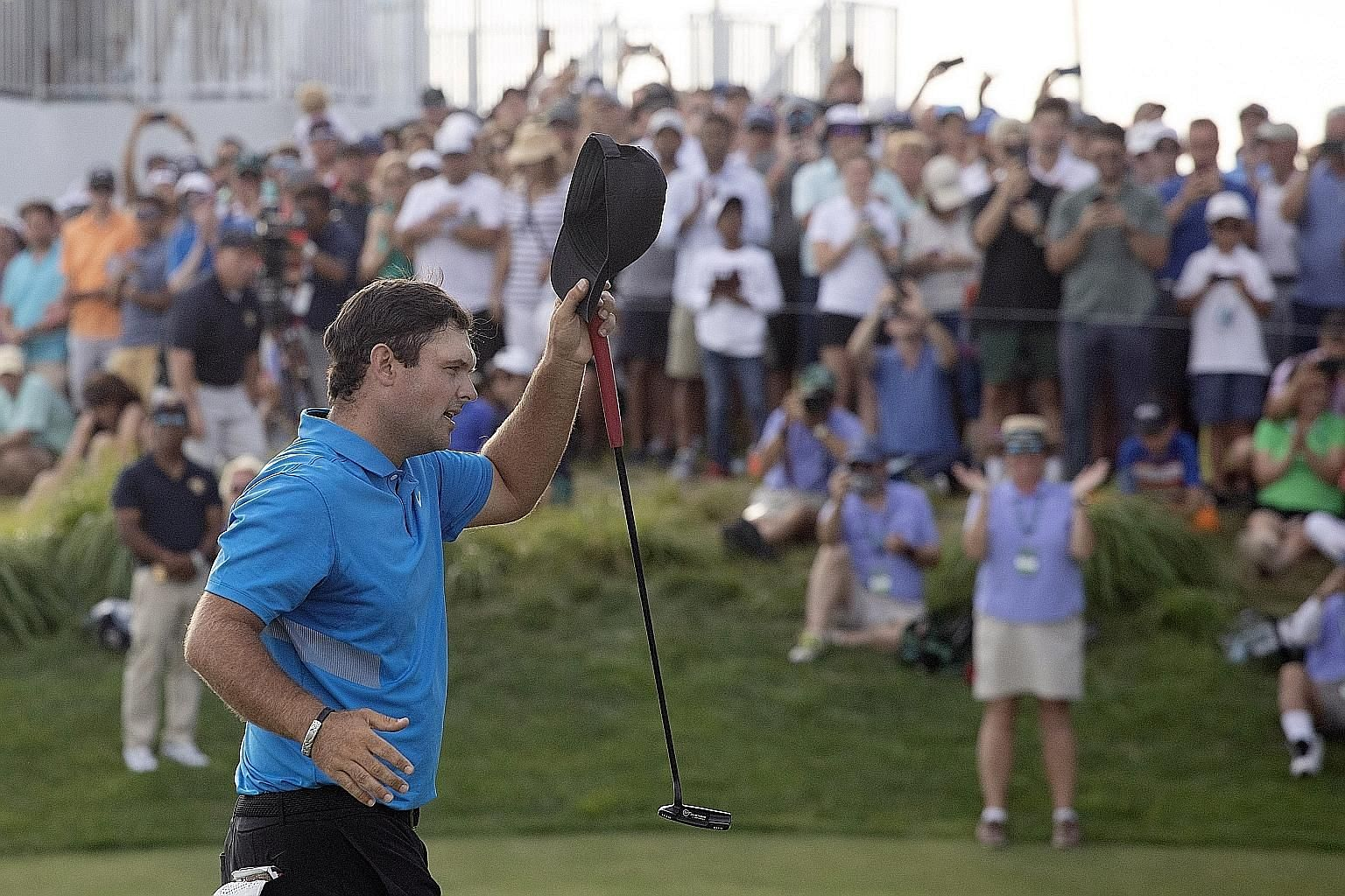 Patrick Reed tipping his cap on the 18th hole at the Liberty National Golf Course, after sealing his one-shot victory. His win in New Jersey was his first title since claiming last year's Masters at Augusta. PHOTO: ASSOCIATED PRESS