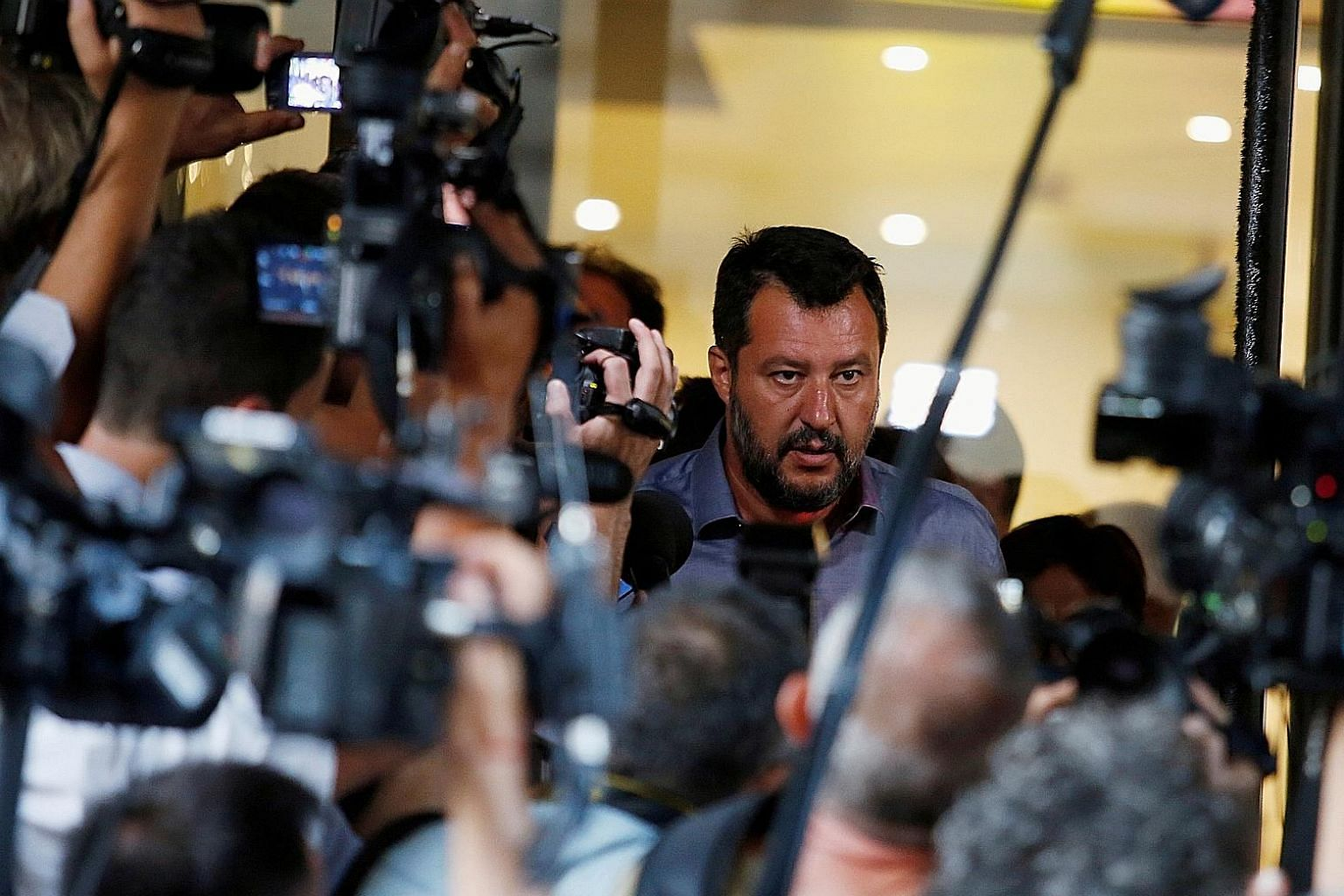 """""""Give us full powers to save Italy"""" - that is the constant refrain of Mr Matteo Salvini, the leader of the anti-immigrant League, seen here speaking to the media on Monday. PHOTO: REUTERS"""