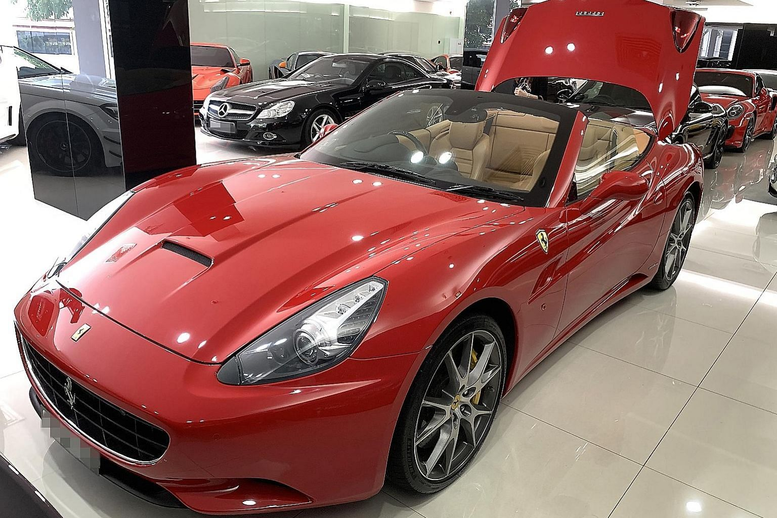 With the loophole in car loan regulations, a buyer can get a 90 per cent loan option for this pre-owned Ferrari priced at $298,000, which means only $30,000 is required for the cash down payment instead of $119,200.