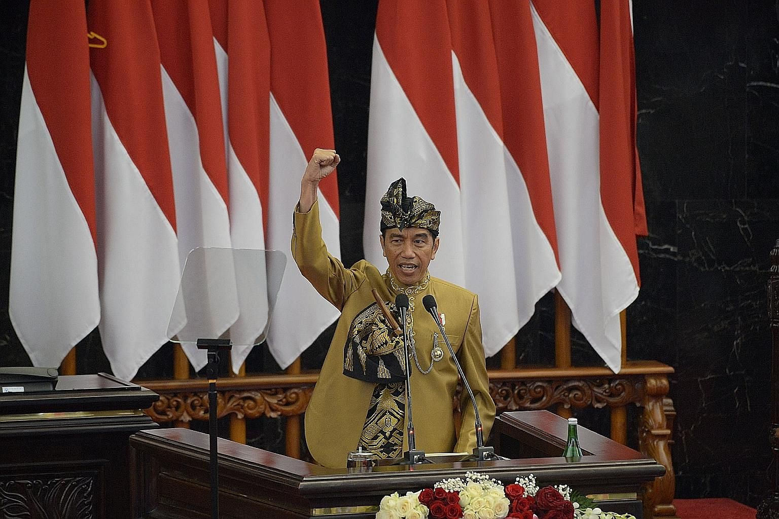 Indonesian President Joko Widodo, in the traditional attire of the Sasak tribe from Lombok island, delivering a speech in Parliament in Jakarta yesterday, ahead of the country's Independence Day today.
