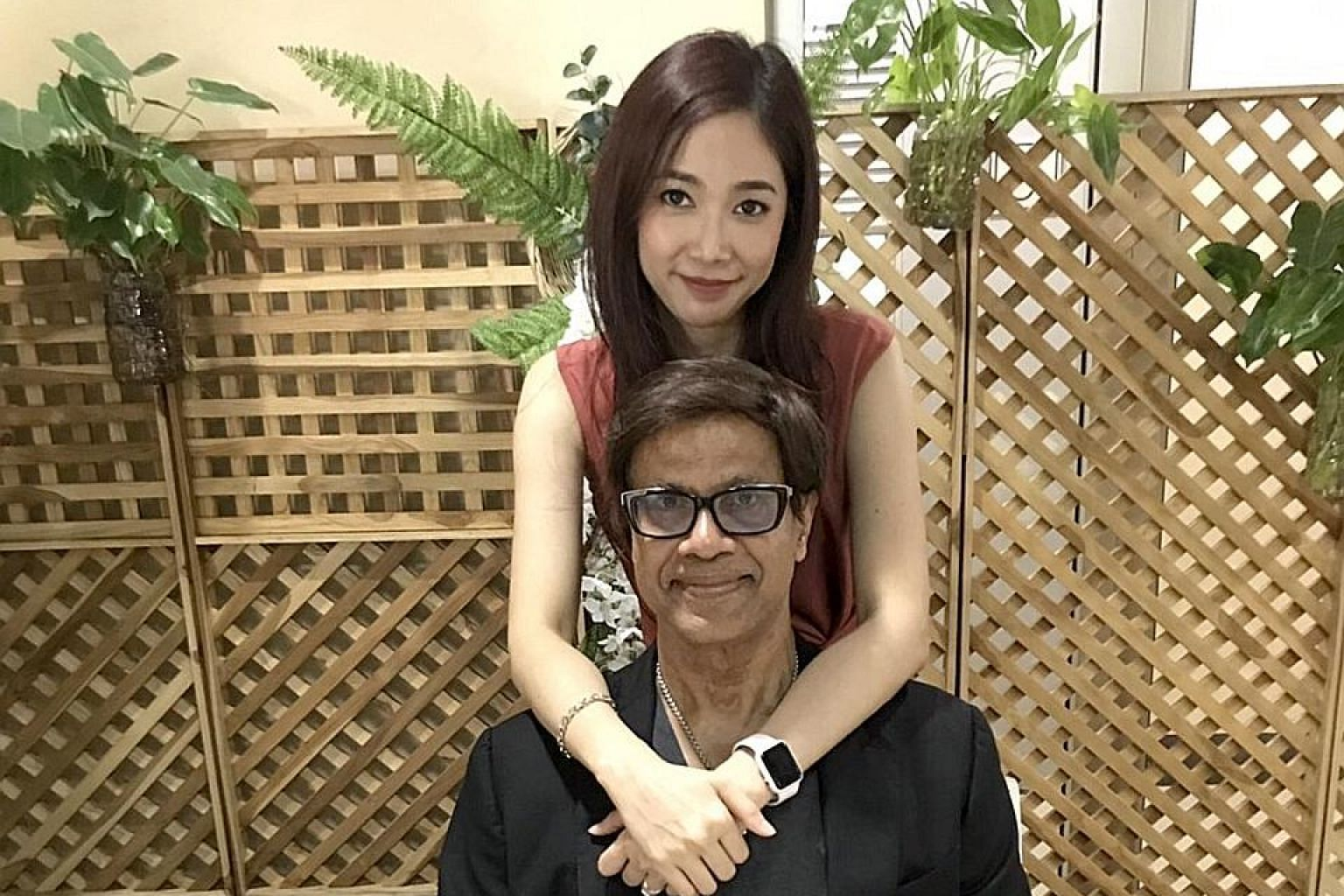 Dr Gobinathan Devathasan, 70, with his new wife, 33-year-old Thai-born Leena Soalsung, whom he married last month. PHOTO: COURTESY OF GOBINATHAN DEVATHASAN