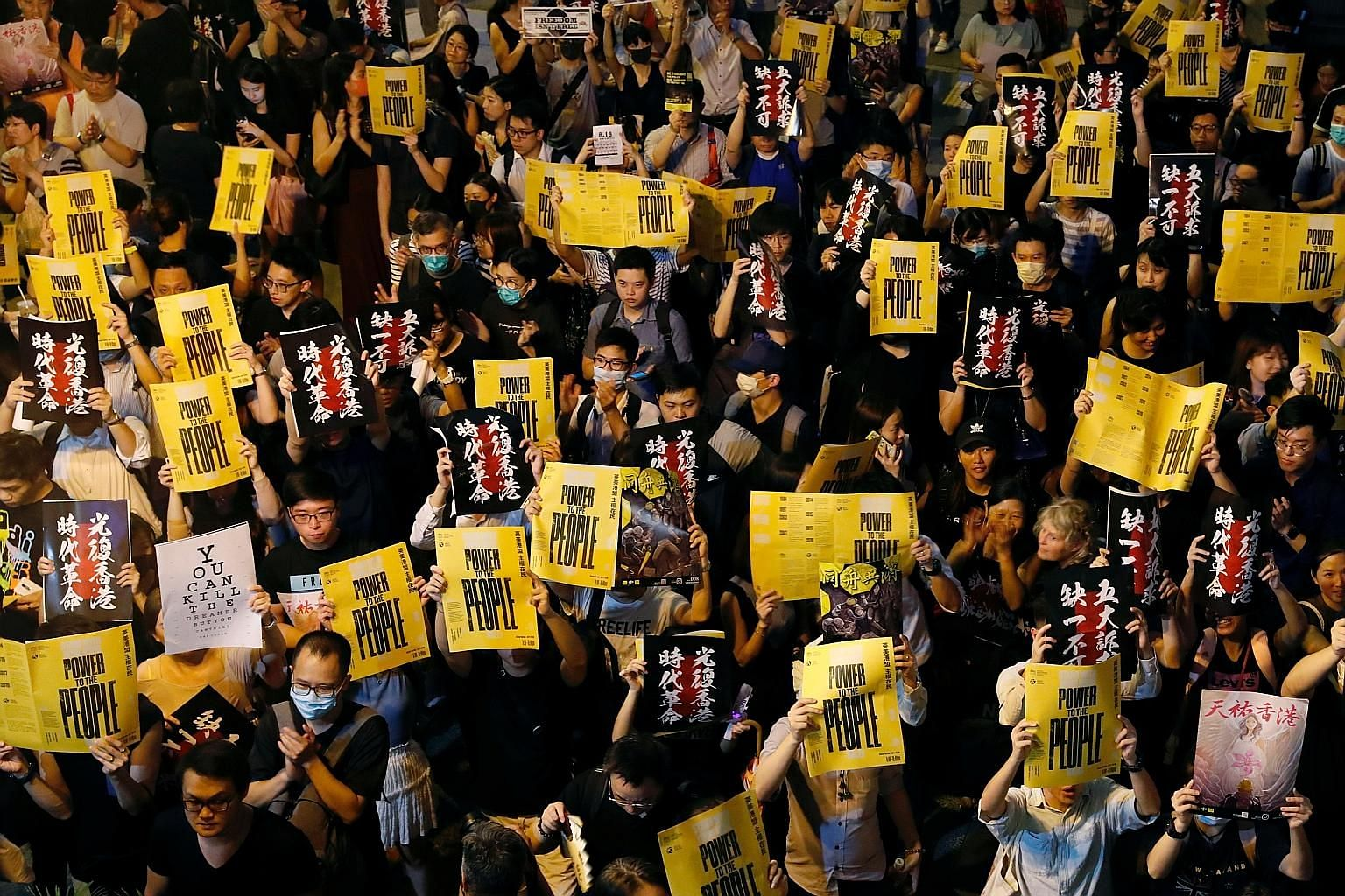 """Protesters at a rally yesterday calling for the United States and Britain to impose sanctions against Hong Kong officials """"complicit in the suppression of rights and freedoms in Hong Kong""""."""