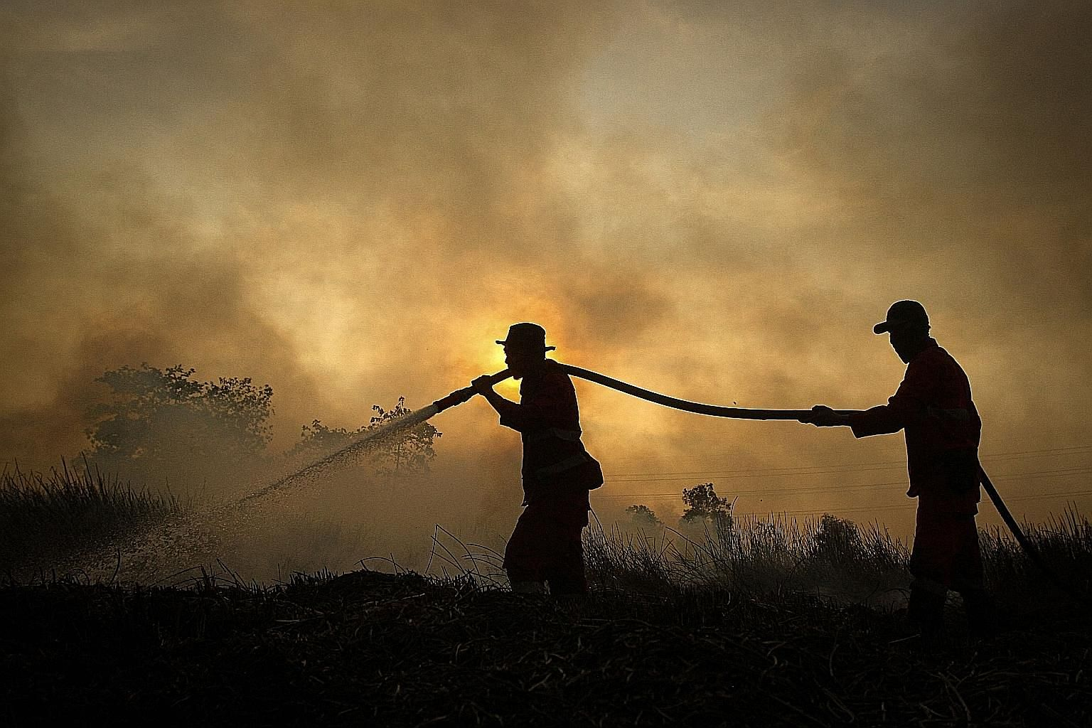 Indonesian firefighters battling a fire earlier this month at a peatland forest in Ogan Ilir, South Sumatra. The Indonesian authorities are deploying thousands of extra personnel to prevent a repeat of the 2015 fires, which were the worst for two dec