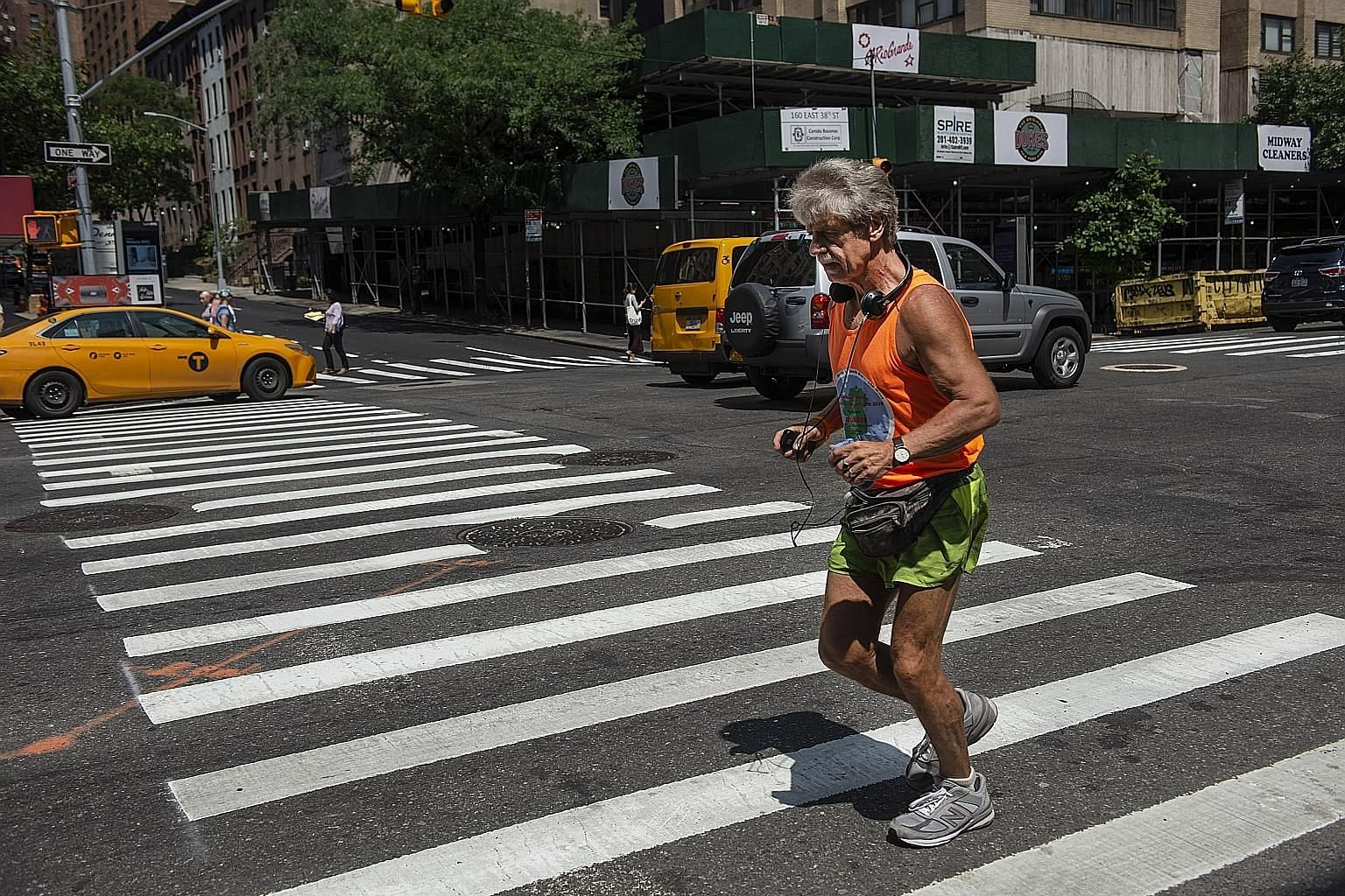 Mr Tom McGrath, 69, seen here on a run in New York earlier this month, is a star of the extreme long distance marathon sport of ultrarunning.