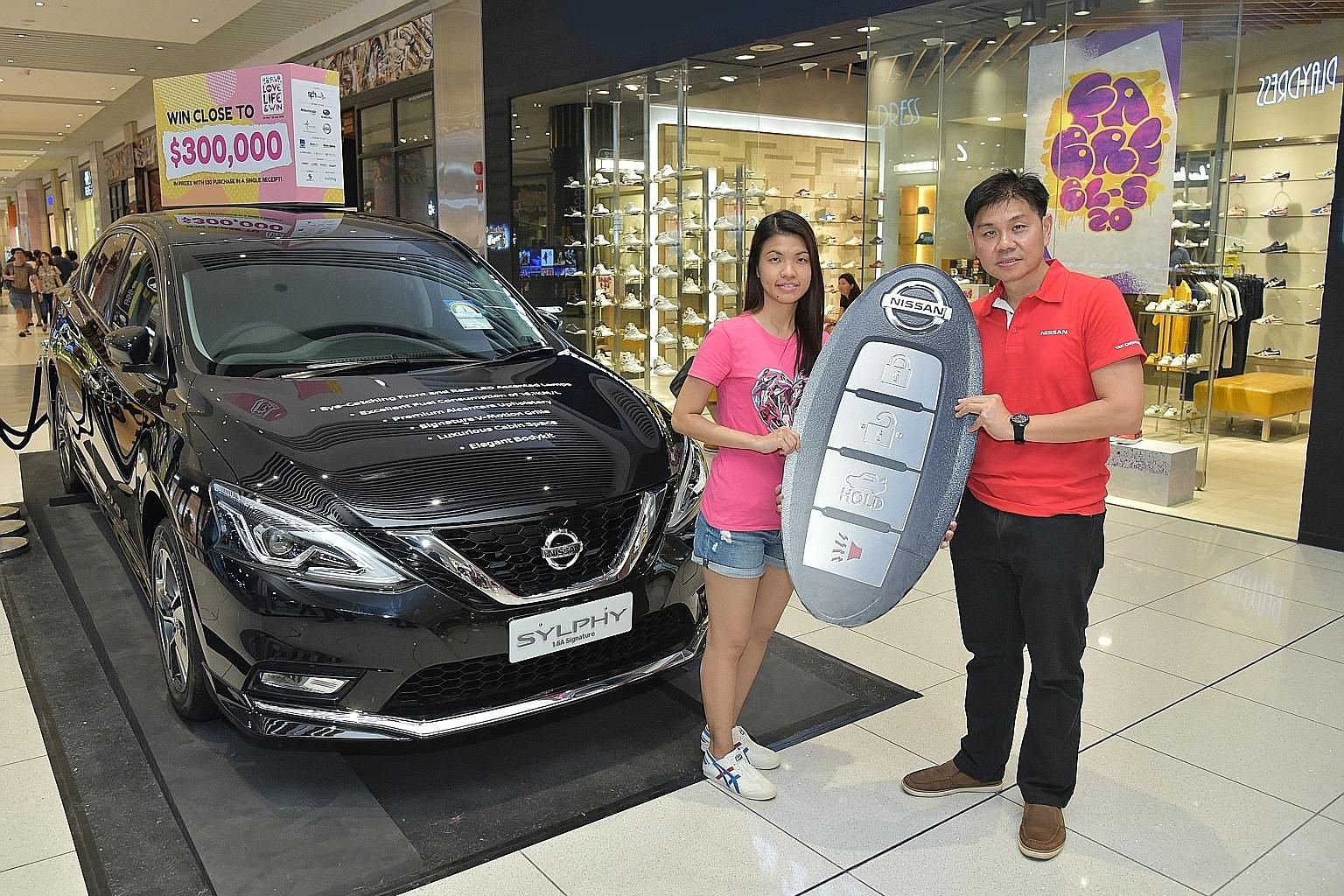 Bank analyst Chia Li Ying does not know how to drive a car. But she may very well have to learn after she won a Nissan Sylphy 1.6 litre sedan as part of the Singapore Press Holdings Love Life & Win Grand Live Draw held yesterday at Suntec City Mall.