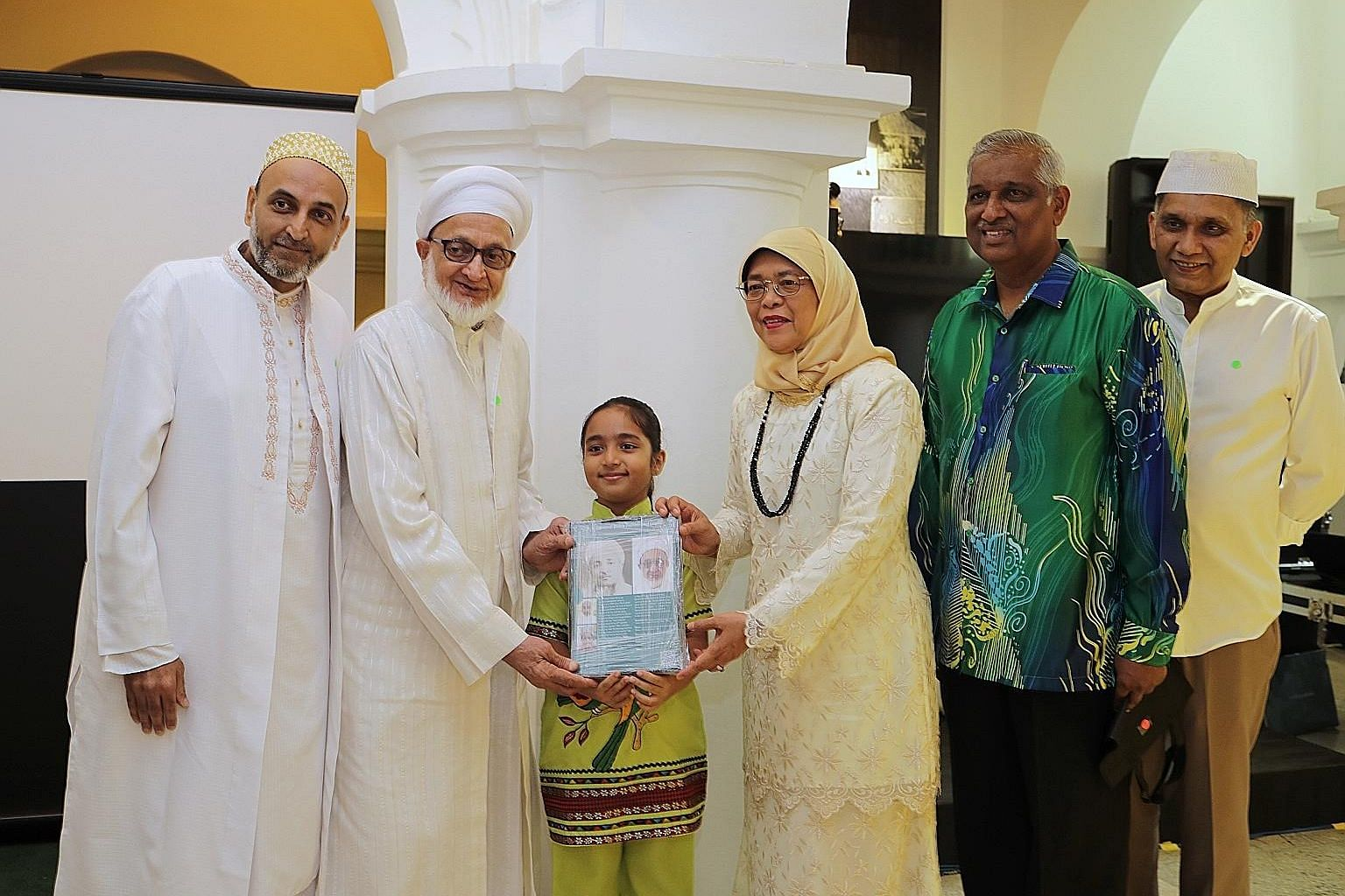 From left: Mr Shaikh Tayebali Khumusi, Mr Mazher Tayeb, Rashida Khumusi, President Halimah Yacob, Mr Naseer Ghani, secretary of the Nagore Dargah Indian Muslim Heritage Centre, and Mr Abdul Jaleel, the centre's chairman, at yesterday's event thanking