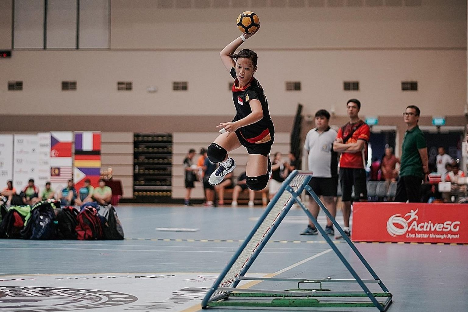 Celine Sheum scoring a goal as the Singapore U-18 girls beat Chinese Taipei 38-30 in the final at the World Youth Tchoukball Championships. ST PHOTO: ONG WEE KIAT