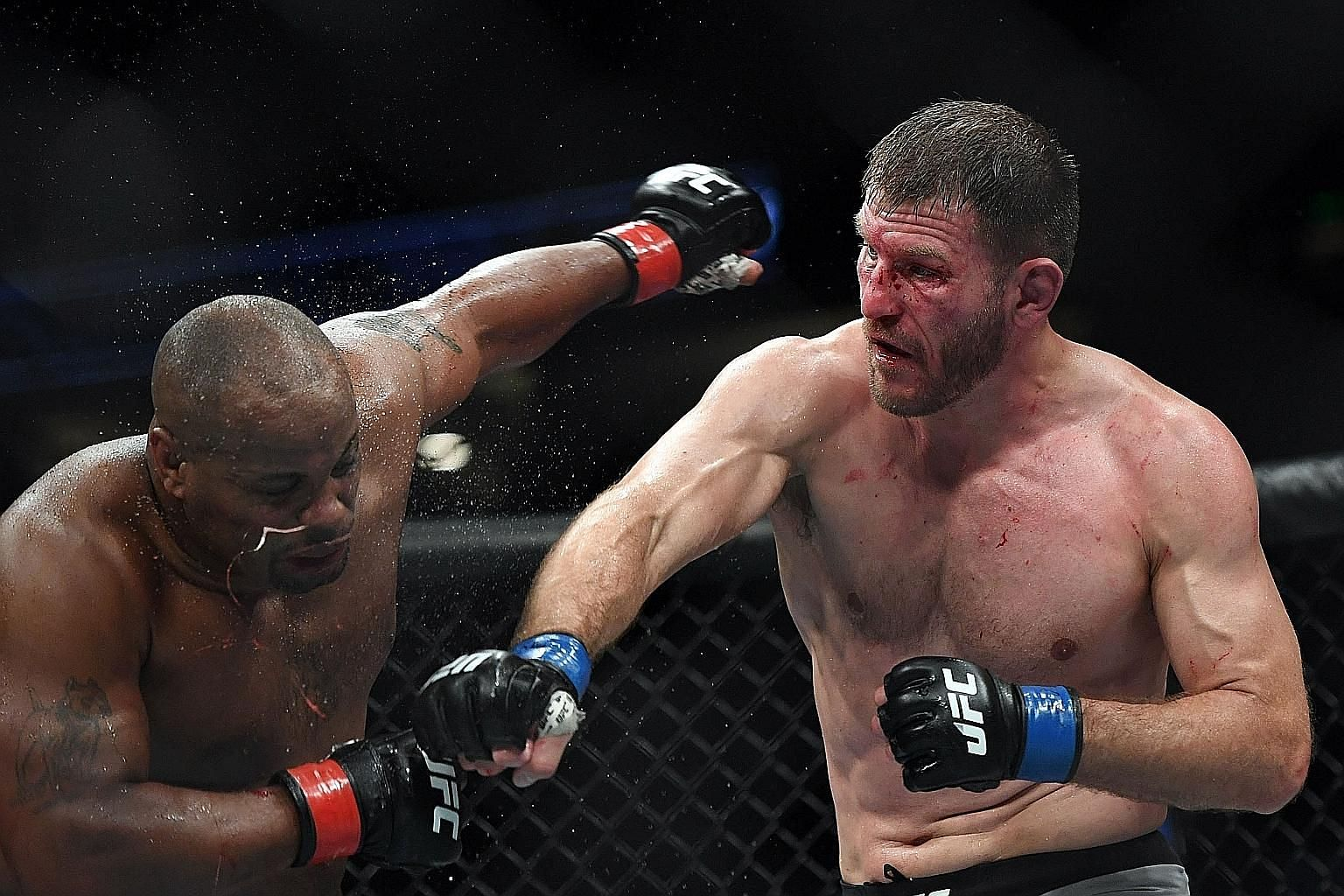 Stipe Miocic punishing Daniel Cormier with a heavy blow during their UFC 241 heavyweight title bout at Honda Center in Anaheim on Saturday. Miocic won with a fourth-round knockout. PHOTO: DPA
