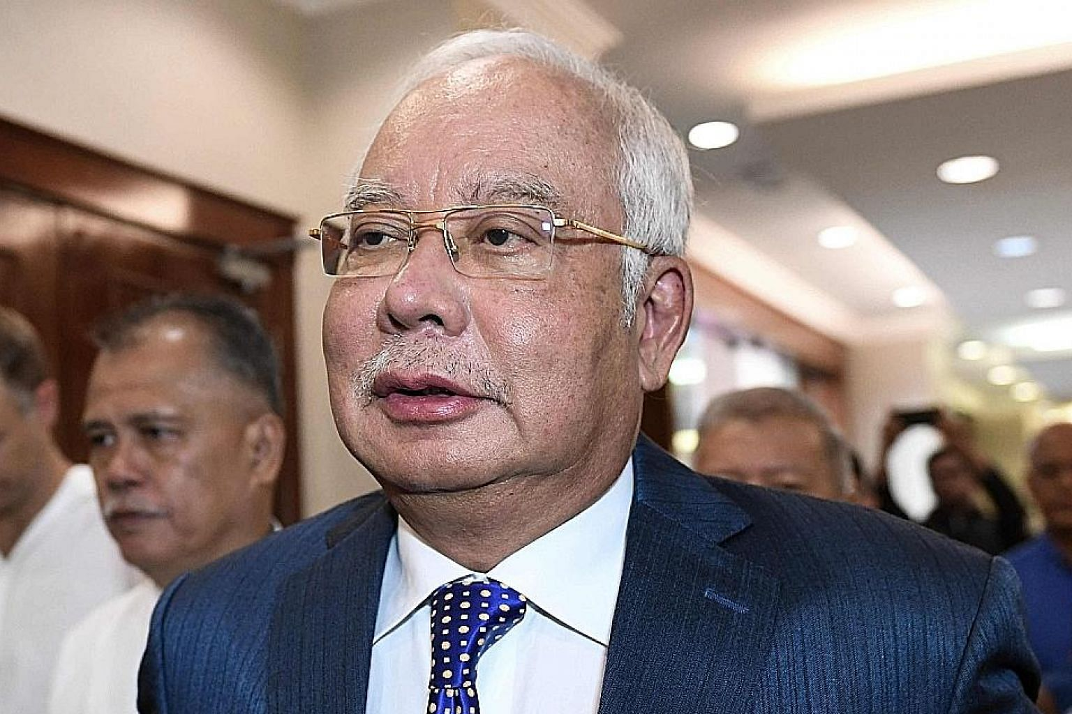 Former Malaysian prime minister Najib Razak is facing 21 charges of money laundering and four of abuse of power for receiving illegal transfers totalling about RM2.3 billion (S$763 million). PHOTO: AGENCE FRANCE-PRESSE
