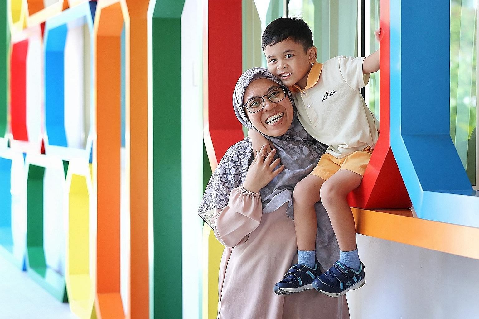 Housewife Shariza Sahari, 42, with her six-year-old son, Aqeel, who has autism. Mother and son go to the Awwa Early Intervention Centre in Fernvale three times a week. At a peer coaching and support session at the centre called Kopi Chat, Madam Shari