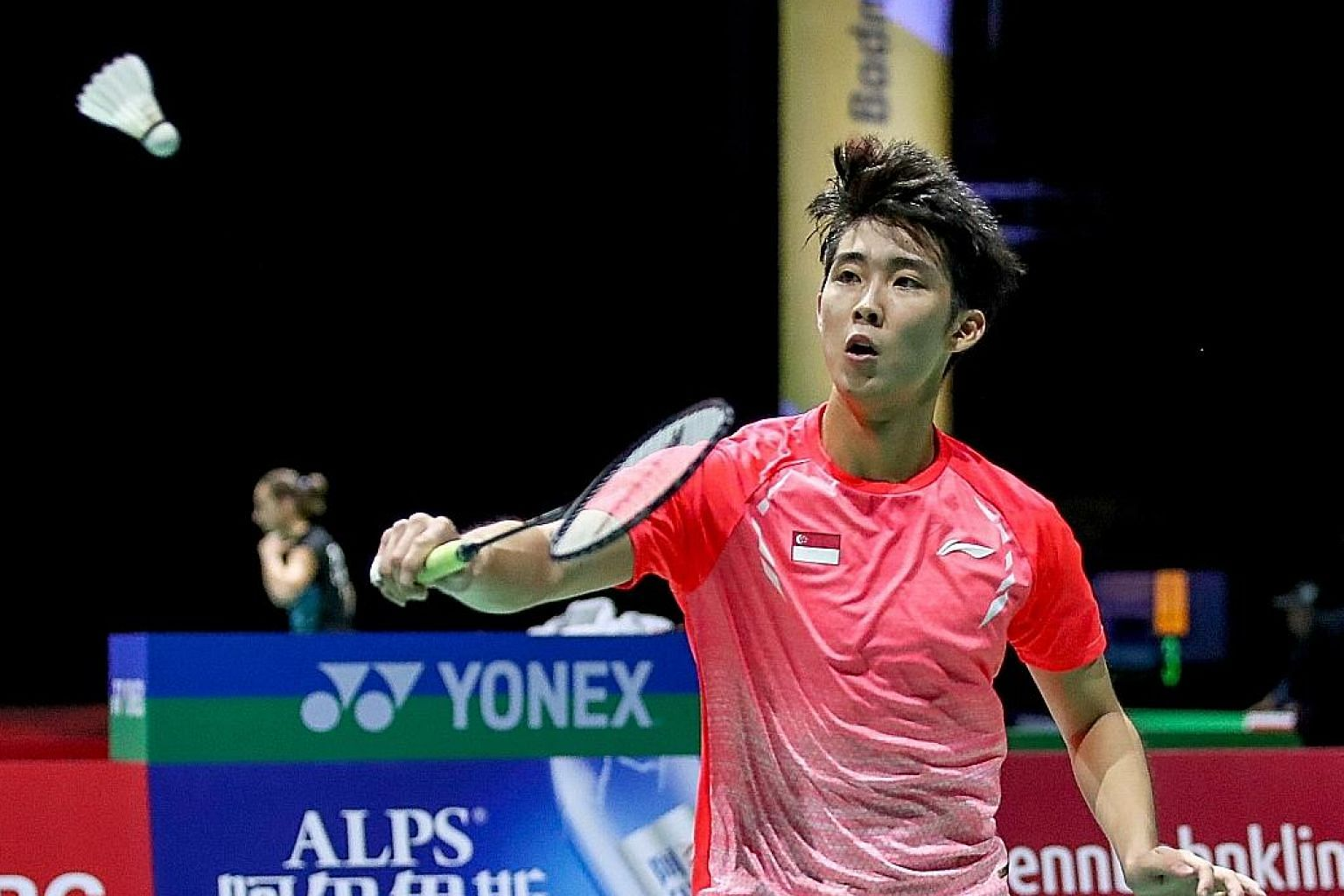 Singapore shuttler Loh Kean Yew hitting a backhand return en route to beating Thomas Rouxel in the second round of the World Championships yesterday. Loh will next face second seed Chou Tien-chen in Basel, Switzerland. PHOTO: BADMINTONPHOTO