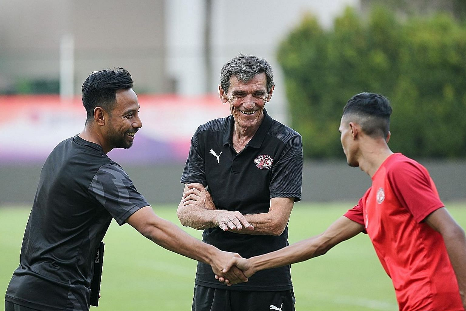 Former Home United coach Raddy Avramovic pictured with assistant coach Noh Rahman (far left) and Home player Aqhari Abdullah during a training session in July. He stepped down on Sunday to return to Serbia for cancer treatment. ST FILE PHOTO