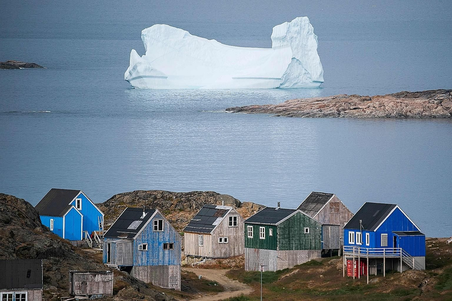 The town of Kulusuk in Greenland, a Danish self-governed territory. Referring to how US President Donald Trump recently scrapped a planned state visit to Denmark after being told that Greenland was not for sale, the writer says it is beyond the absur