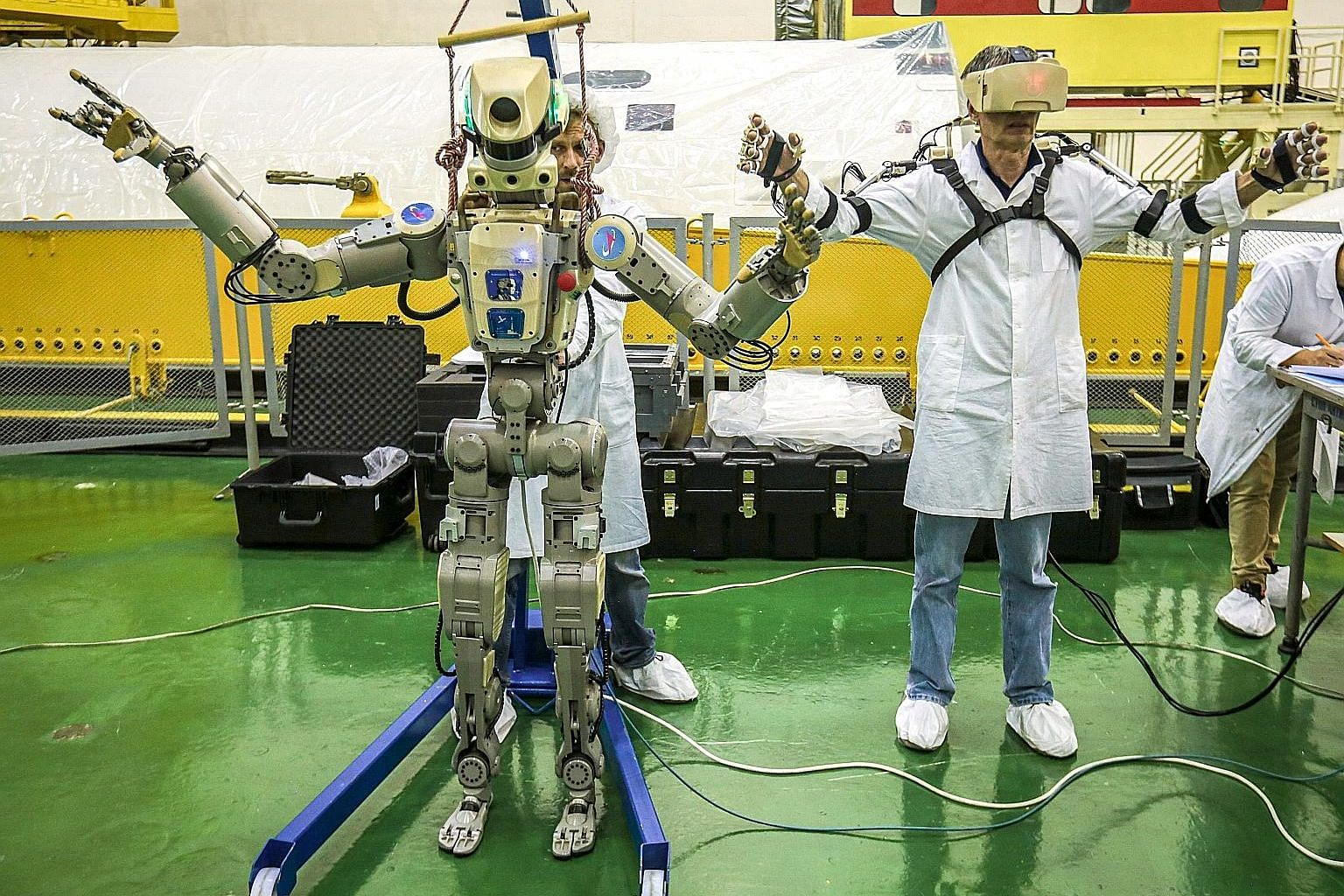 Russia's humanoid robot, Fedor, being tested last month ahead of its flight yesterday on board the Soyuz MS-14 spacecraft bound for the International Space Station. Fedor copies human movements, a key skill that allows it to remotely help astronauts.